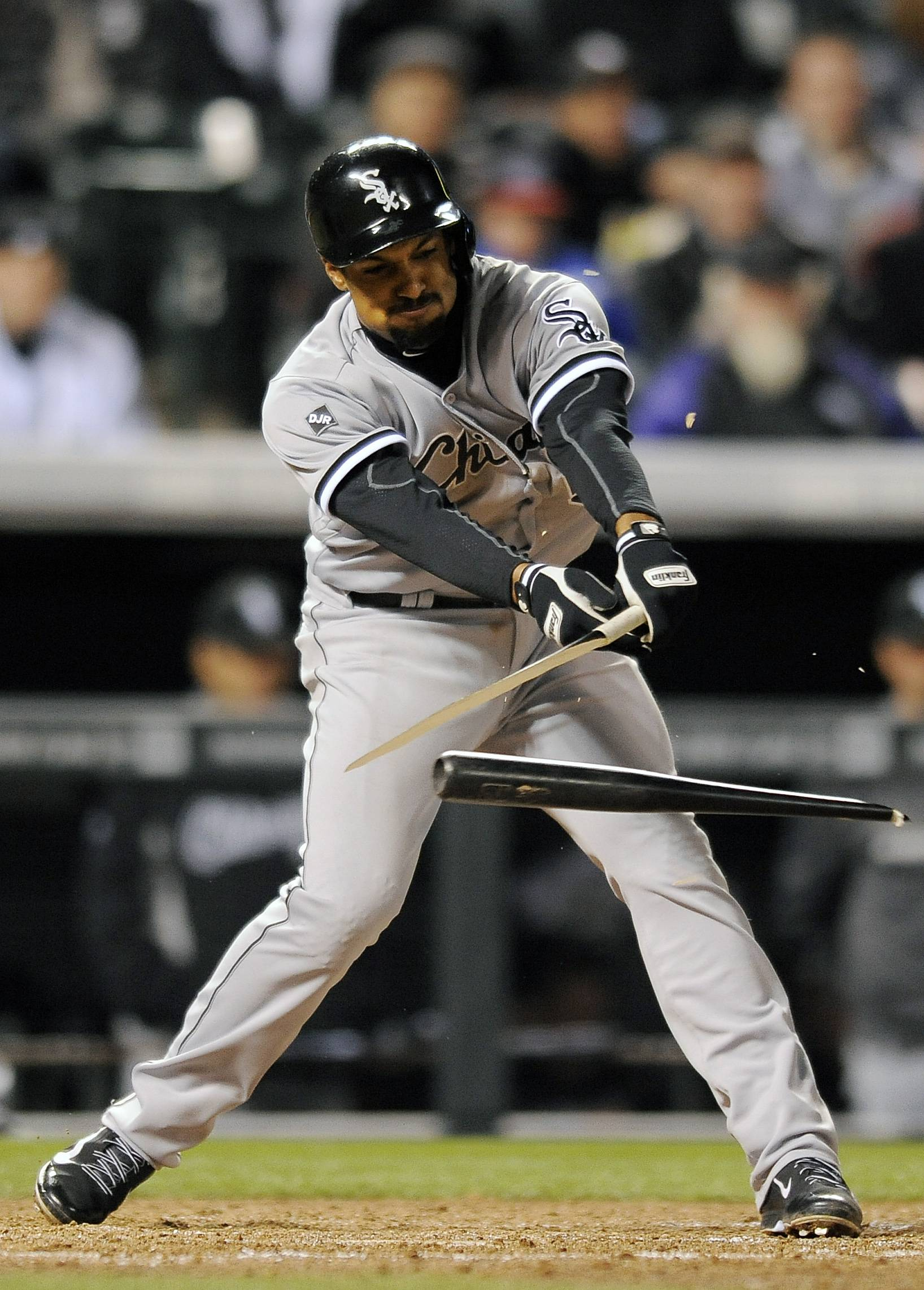 Marcus Semien of the White Sox breaks his bat on a groundout in the sixth inning of the MLB baseball game against the Colorado Rockies on Monday, April 7, 2014, in Denver.