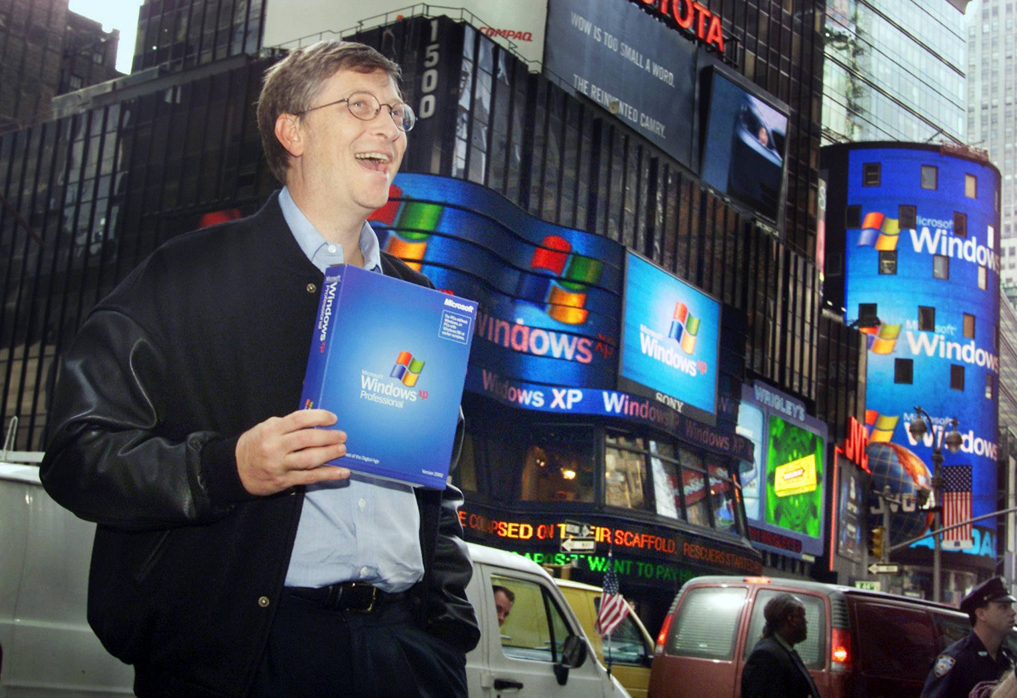 Microsoft chairman Bill Gates stands in New York's Times Square to promote the new Windows XP operating system on Oct. 25, 2001. On Tuesday, Microsoft will end support for its still popular version of Windows -- which is still used by an estimated 30 percent of businesses and consumers.