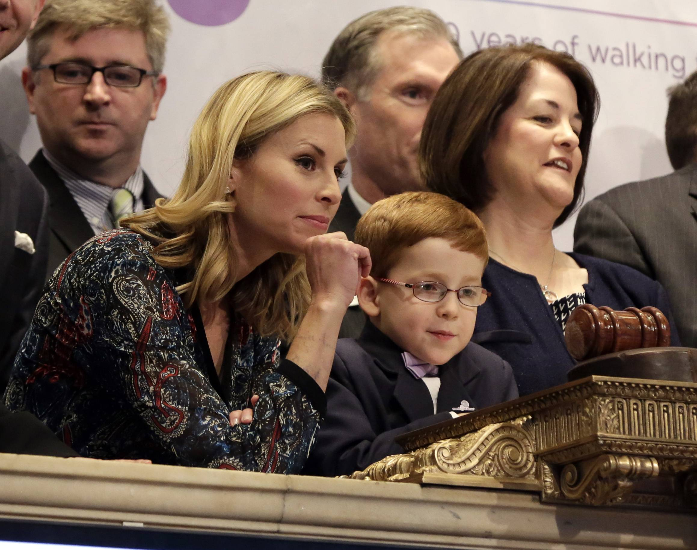 Supermodel Niki Taylor and March of Dimes 2014 National Ambassador Aidan Lamothe watch floor activity from the podium before ringing the New York Stock Exchange closing bell Monday.  U.S. stocks fell, pushing the Nasdaq 100 Index to its biggest three-day retreat since 2011.