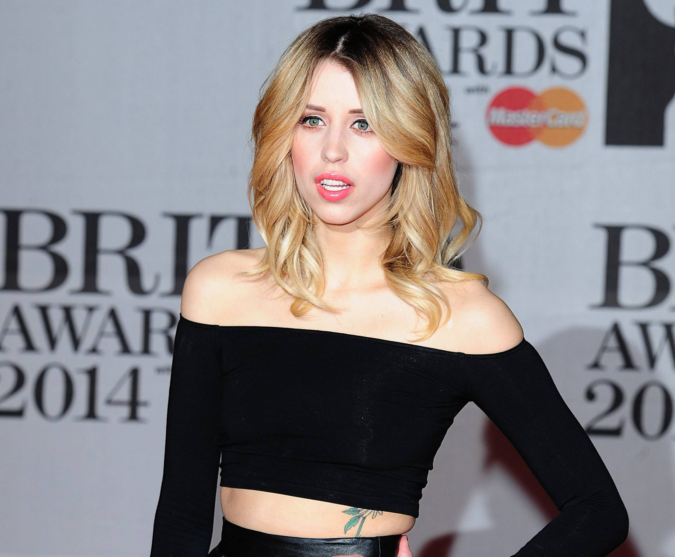 "In this Feb. 19, 2014 file photo Peaches Geldof, daughter of Bob Geldof is seen at the Brit Awards 2014, in London. Peaches Geldof, the model and television presenter who was concert organizer Bob Geldof's daughter, has died at age 25. Bob Geldof said in a statement Monday, April 7, 2014: ""Peaches has died. We are beyond pain."""