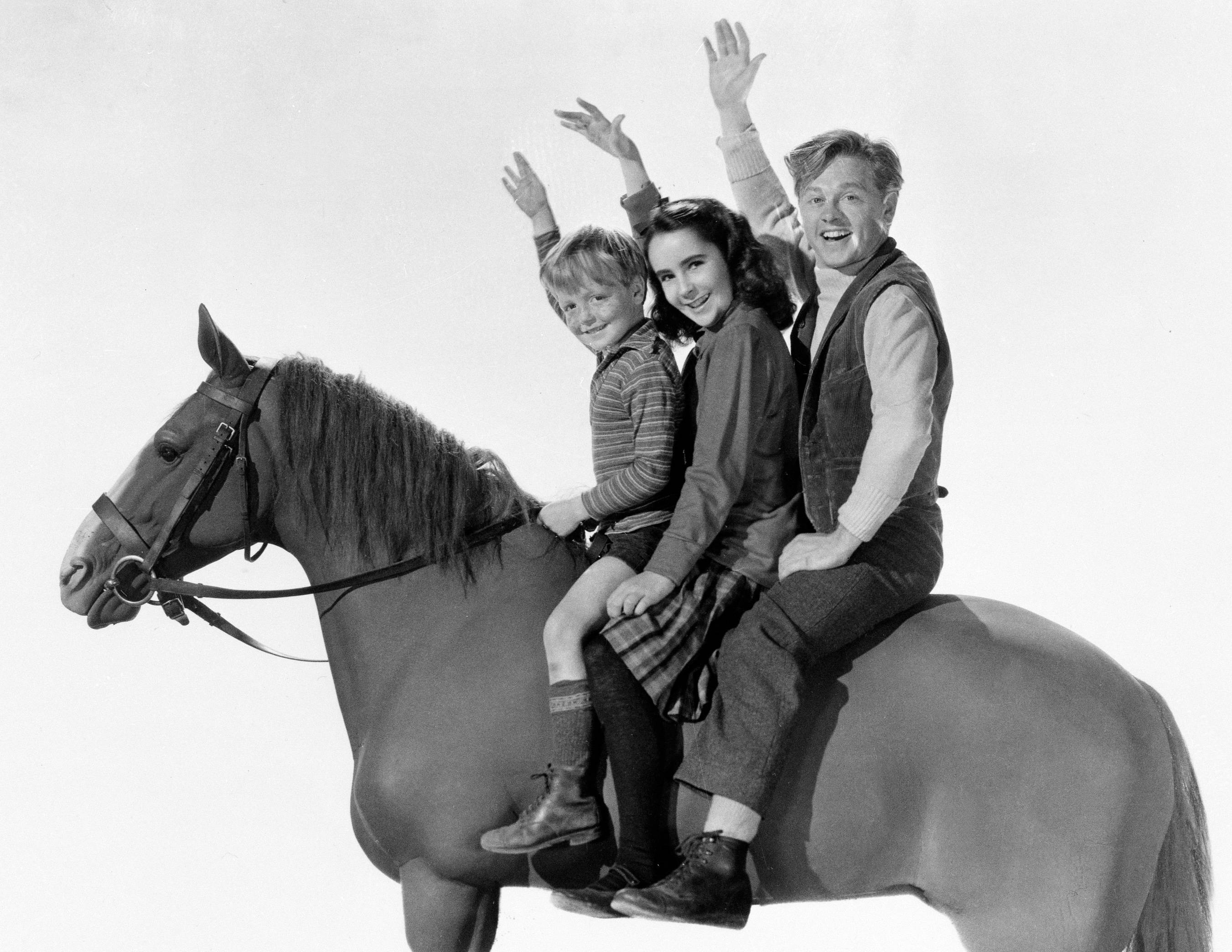 "This is a 1945 publicity image for the film ""National Velvet,"" showing, from left, actors Butch Jenkins, Elizabeth Taylor and Mickey Rooney. Rooney, a Hollywood legend whose career spanned more than 80 years. He was 93."