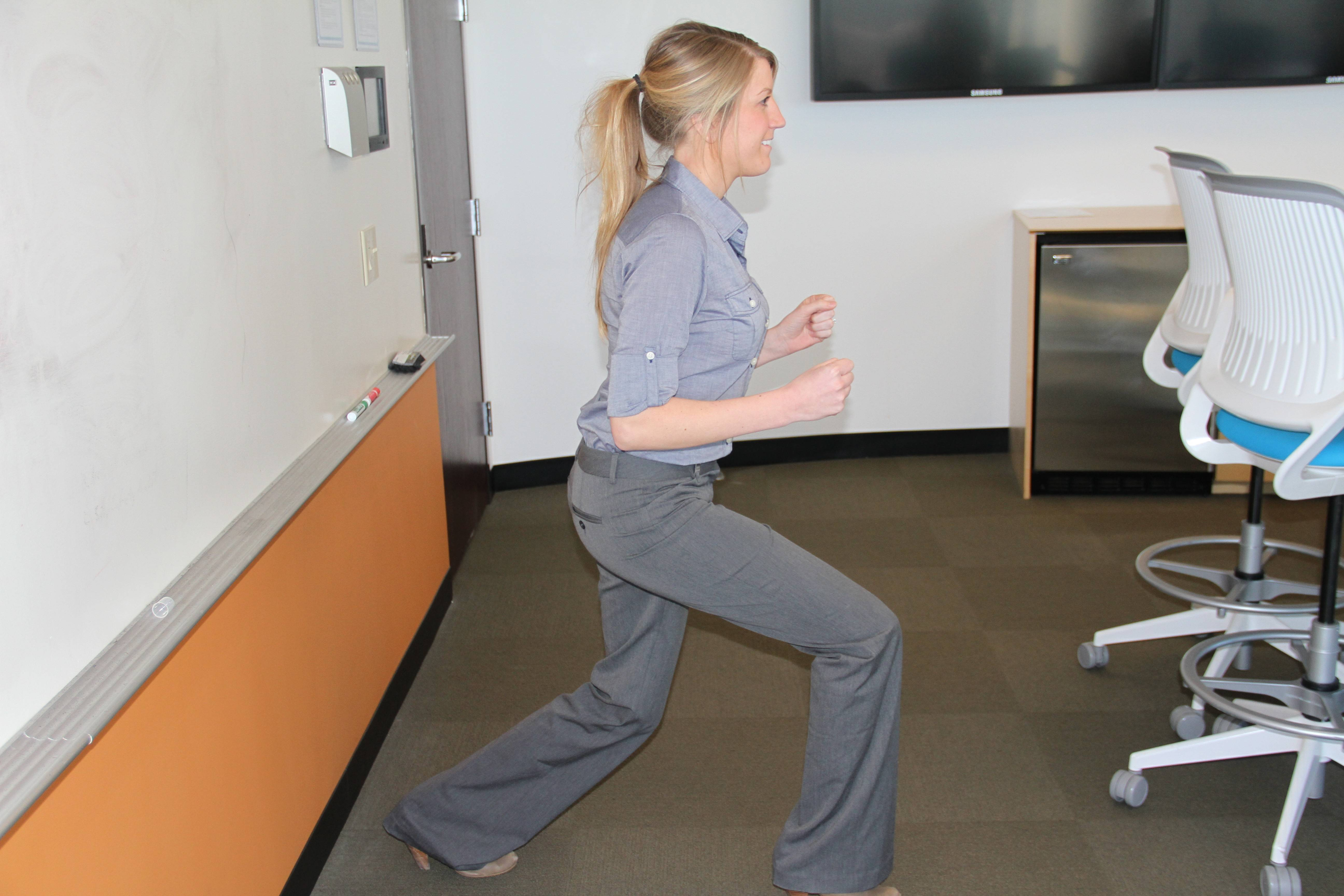 Jill Micklow, wellness specialist at Assurance, captures the fitness spirit with split squat jumps -- in high heels no less.