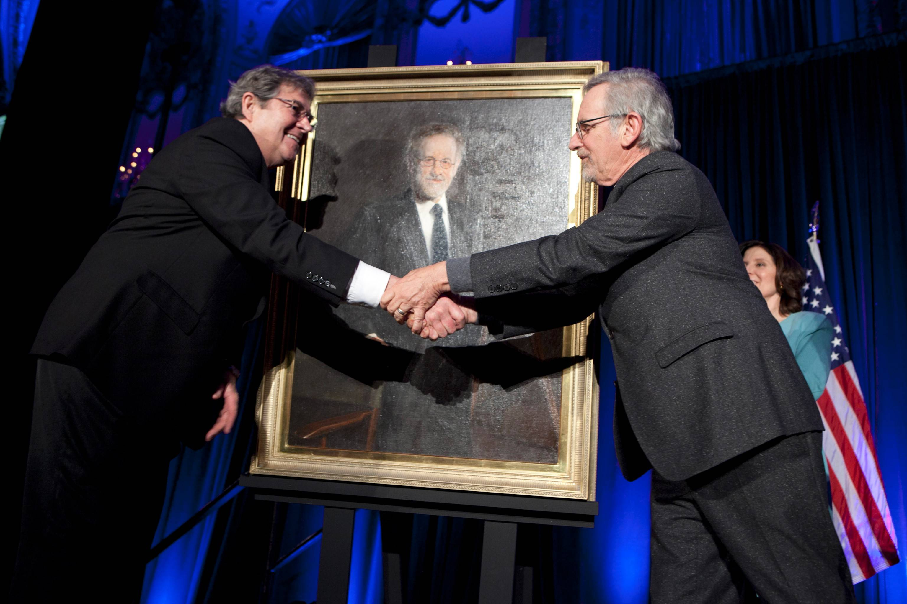 Arlington Heights portrait artist William Chambers shakes hands with Hollywood film director Steven Spielberg at the 2014 Lincoln Leadership Dinner.