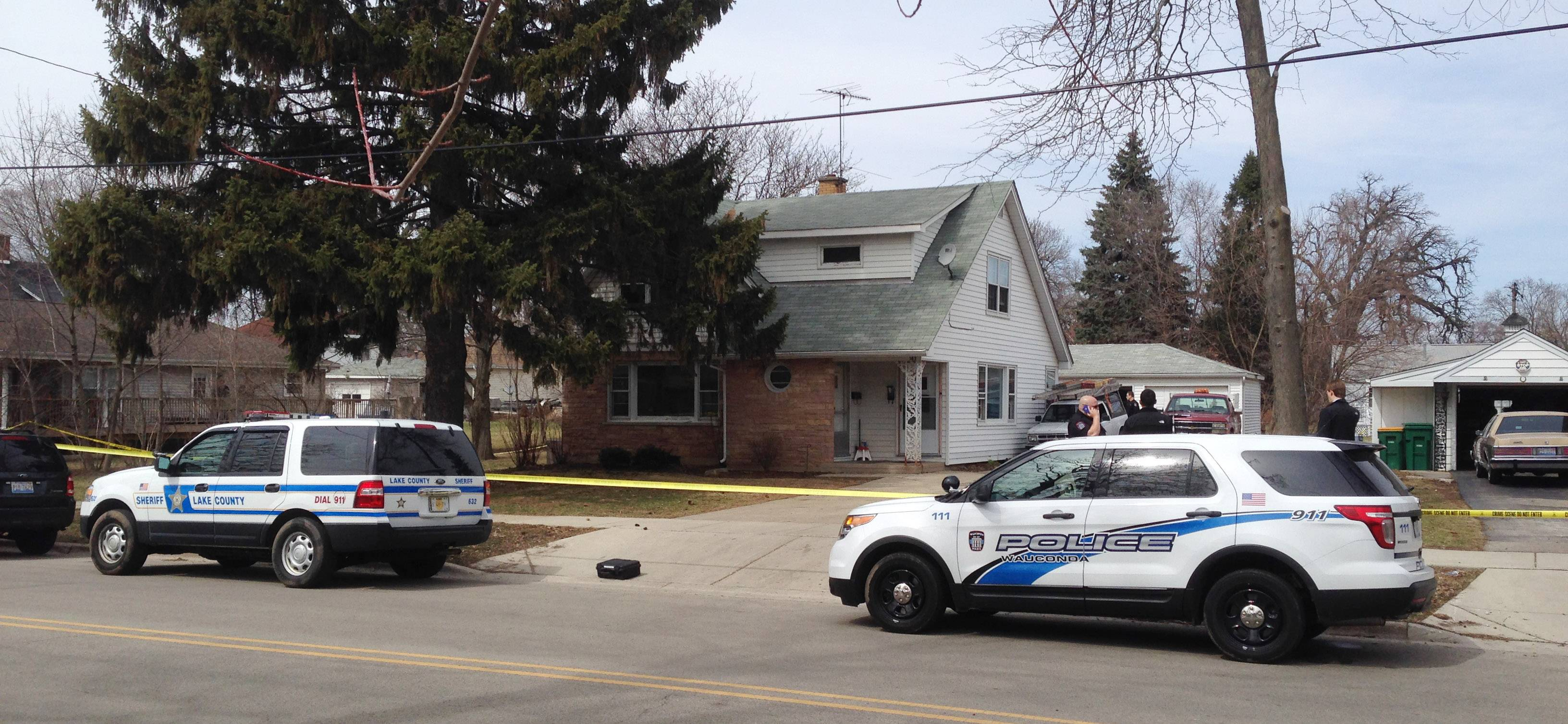 Police officials investigate a shooting Monday on the 100 block of Slocum Lake Road in Wauconda.