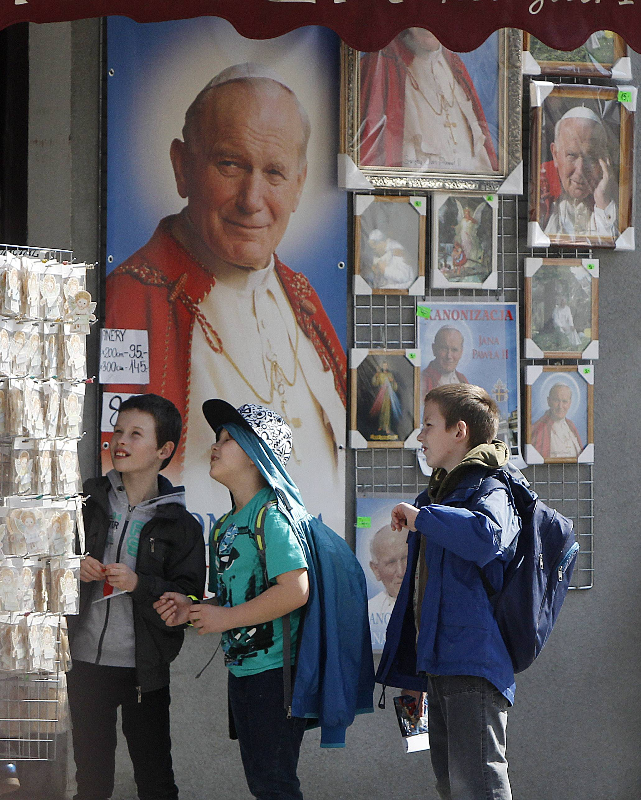 School children are looking at souvenirs of Pope John Paul II in his hometown of Wadowice, Poland on Monday, April 7, 2014. A new multimedia museum to the pope will open this week at his Wadowice birth house just weeks before John Paul II is to be made a saint during a Vatican ceremony, led by Pope Francis on April 27.