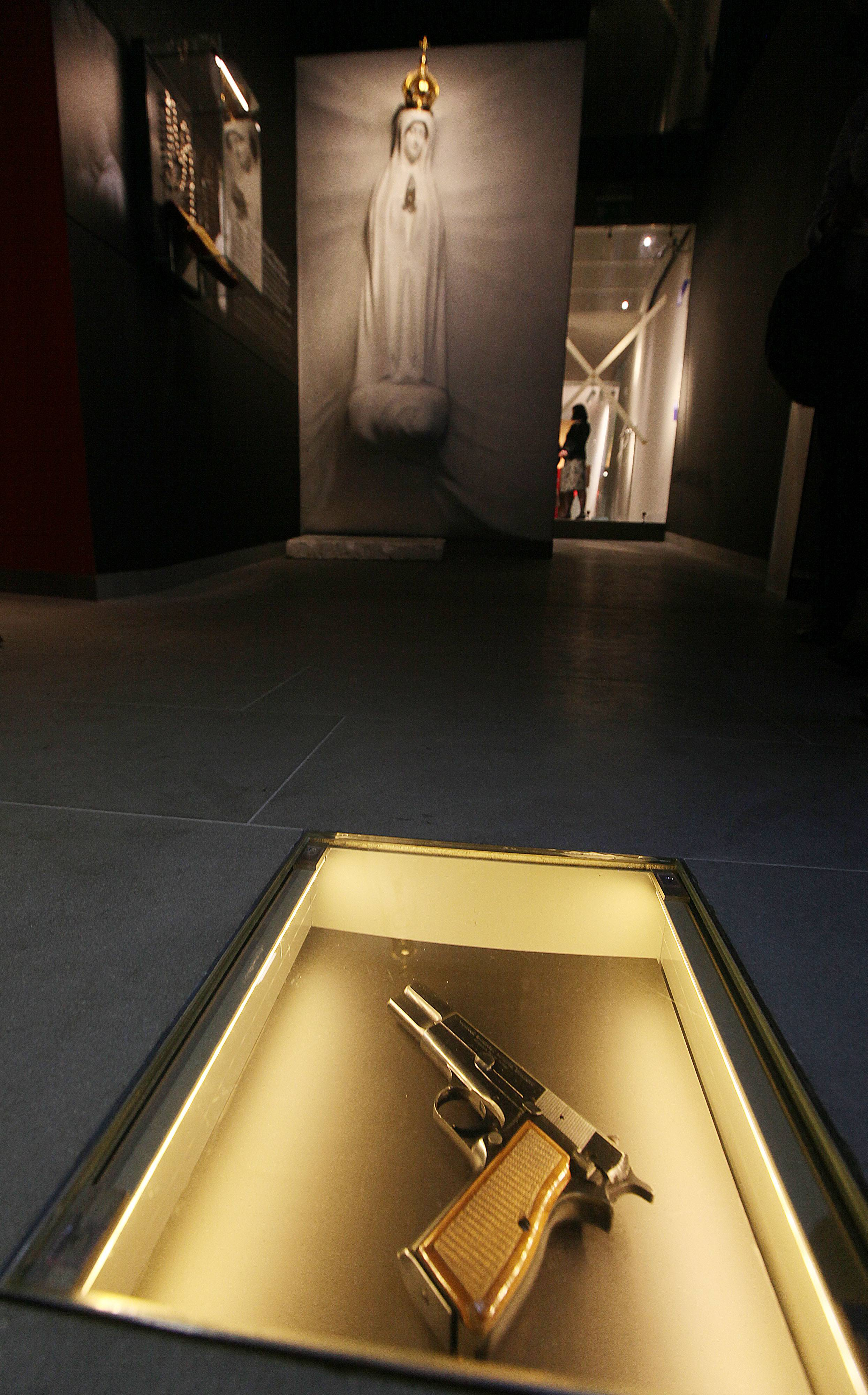 The Browning HP 9 mm handgun that would-be assassin Ali Agca used against Pope John Paul II injuring him in a May 13, 1981 attack in St. Peter's Square in Rome, is pictured at the new Pope Museum in Wadowice, Poland, Monday, April 7, 2014. The gun is among items on display at a new multimedia museum in the Pope's birth house in Wadowice. The museum opens this week, ahead of the Vatican ceremony during which he will be made a saint April 27.