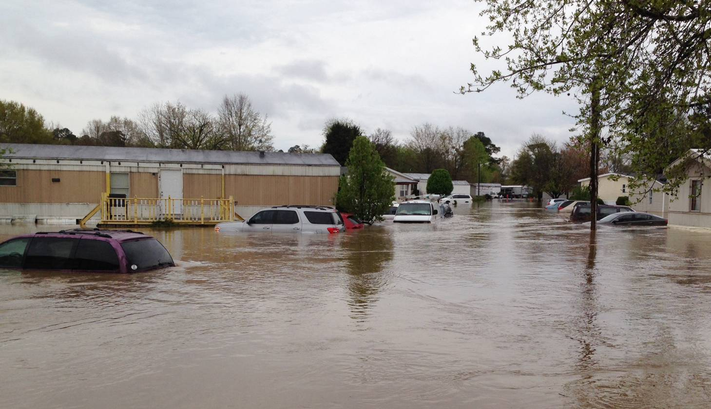 Flood waters cover a street in a mobile home park in Pelham, Ala., on Monday, April 7, 2014. Police and firefighters rescued about a dozen people who were trapped by muddy, fast-moving water after storms dumped torrential rains in central Alabama.