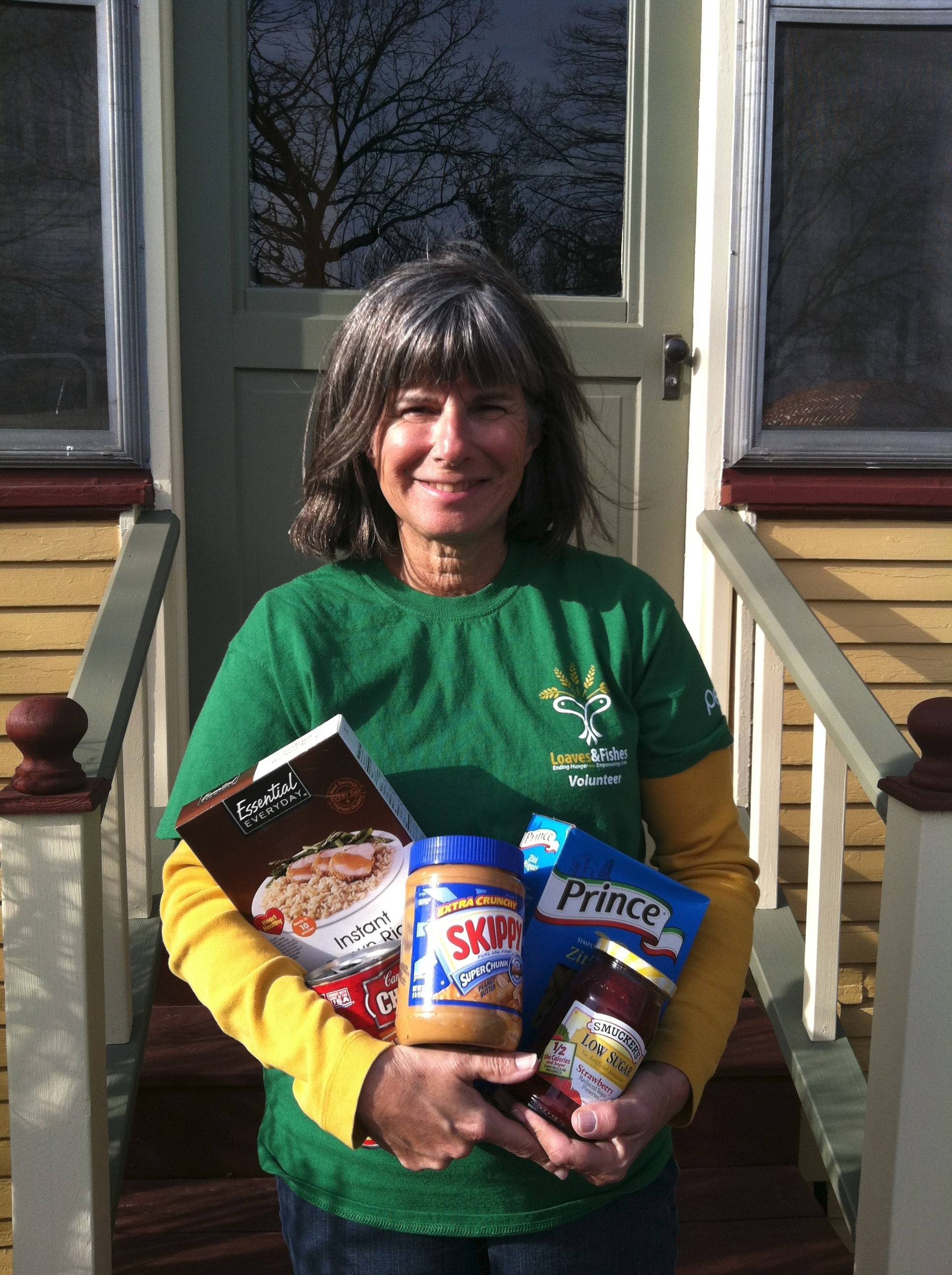 Susan McNeal-Bulak of Naperville volunteers at Loaves and Fishes Community Pantry. She'll raise money for the pantry by joining in the Human Race organized by Giving DuPage.