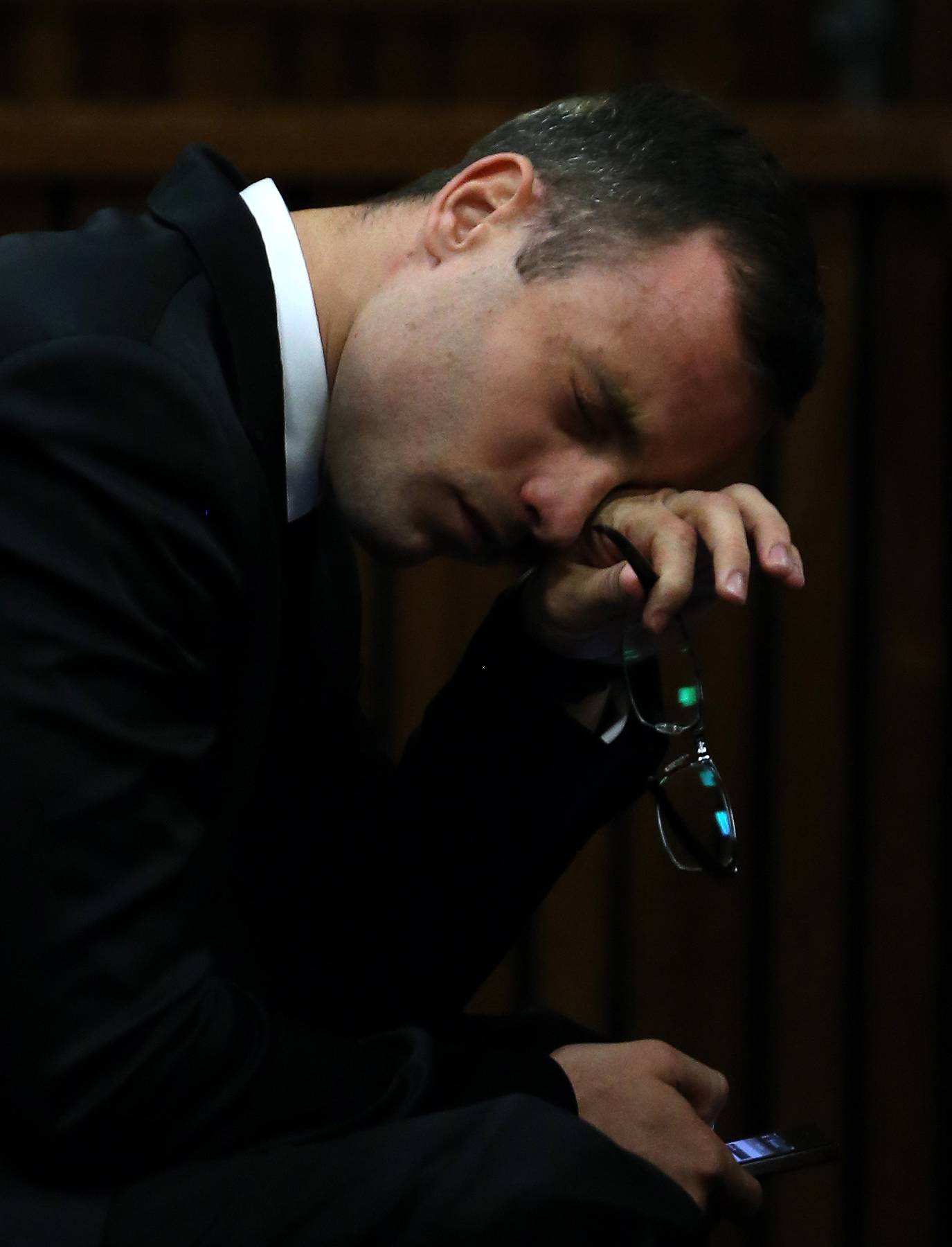 Oscar Pistorius gestures as he listens to evidence by a pathologist in court in Pretoria, South Africa, Monday.
