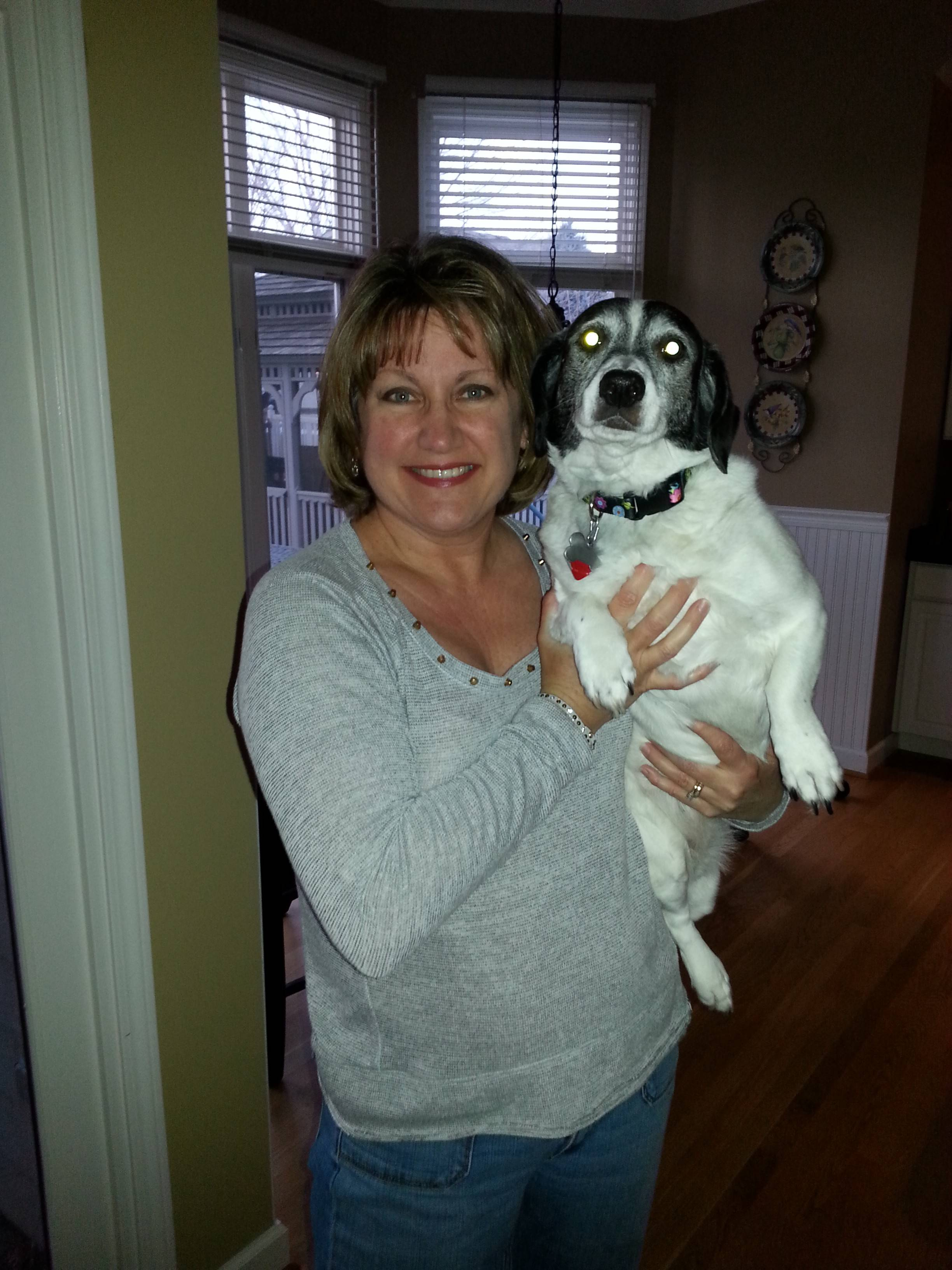 Laura Cosenza, a volunteer with Naperville Humane Society, will join the 2014 Human Race to benefit the organization. In 2013, her dog Maggy, adopted through the shelter, was the first dog to cross the finish line.