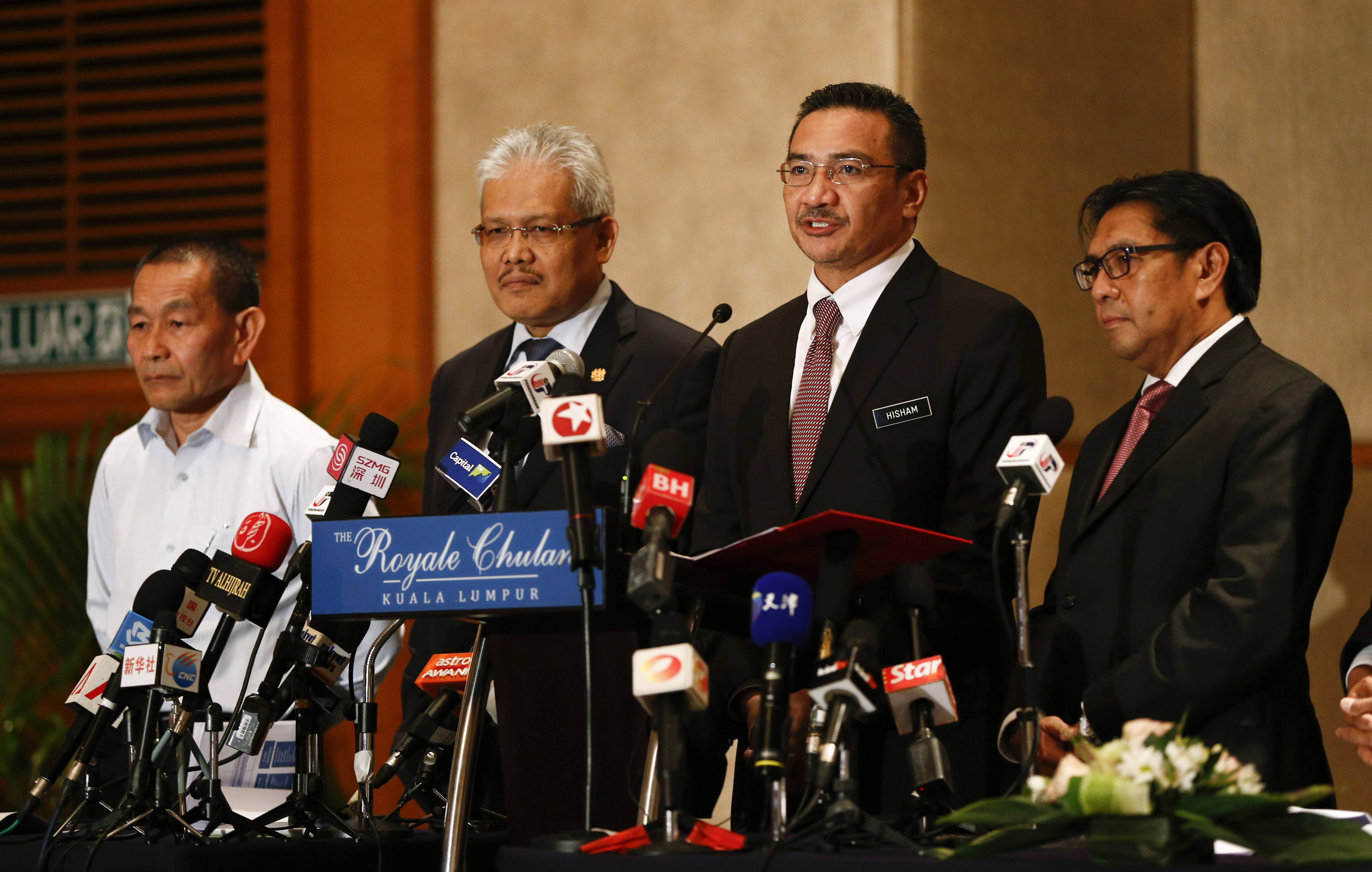 Malaysia's Defense Minister and acting Transport Minister Hishammuddin Hussein, second right, speaks druing a press conference on the missing Malaysia Airlines MH370 at a hotel in Kuala Lumpur, Malaysia, Monday. From left, Malaysia Airlines Group CEO Ahmad Jauhari Yahya, Deputy Minister of Foreign Affairs Hamzah Zainudin, Hishammuddin and Director general of the Malaysian Department of Civil Aviation Azharuddin Abdul Rahman.