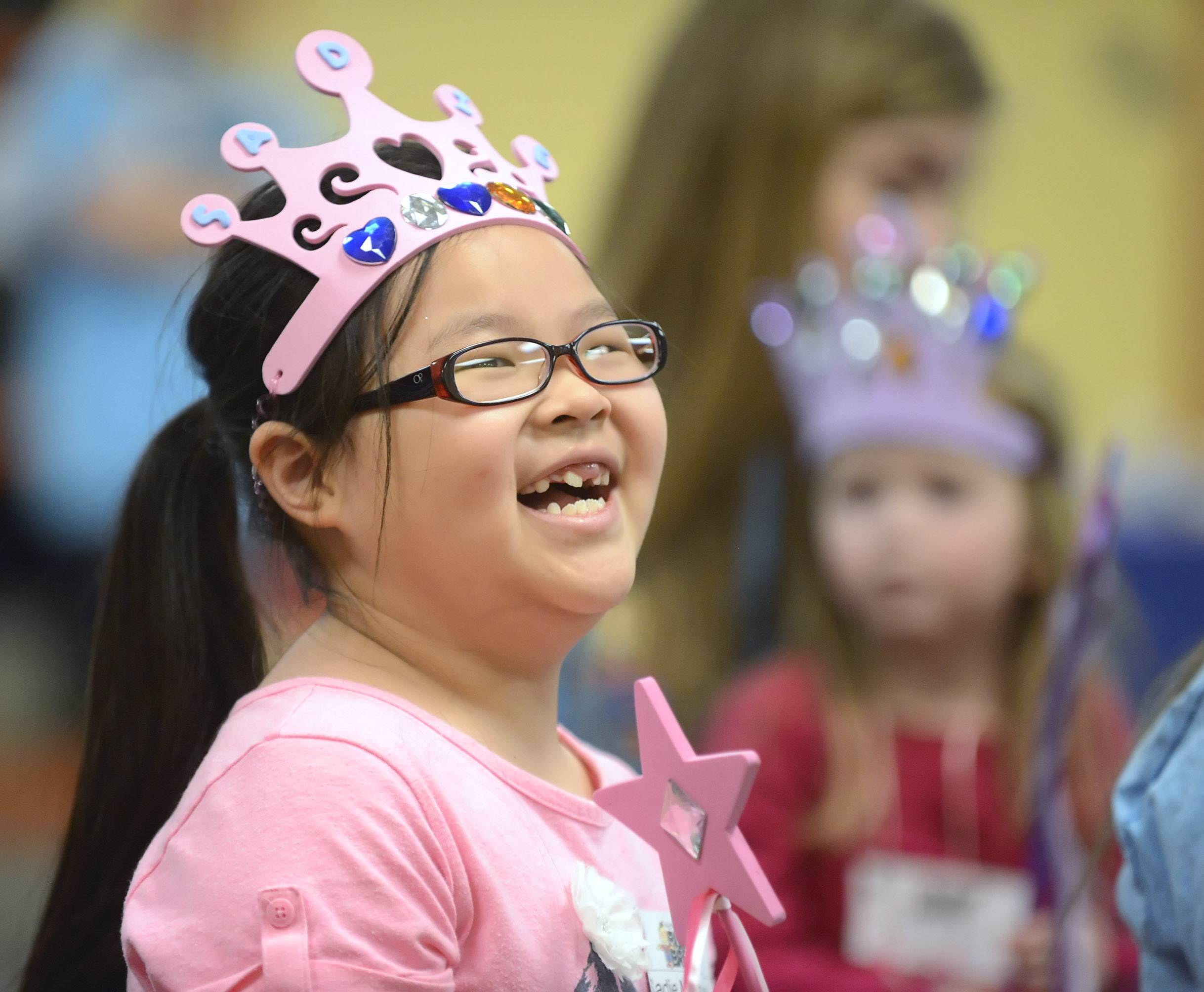 Sadie Marquardt, 7, of Maple Park giggles during a magic show at the second Nathaniel's Hope Buddy Break session at First Baptist Church in Geneva. The free event offered kids with special needs and their siblings an afternoon with a magic show, video games, a cars and trains room, crafts and free play time.