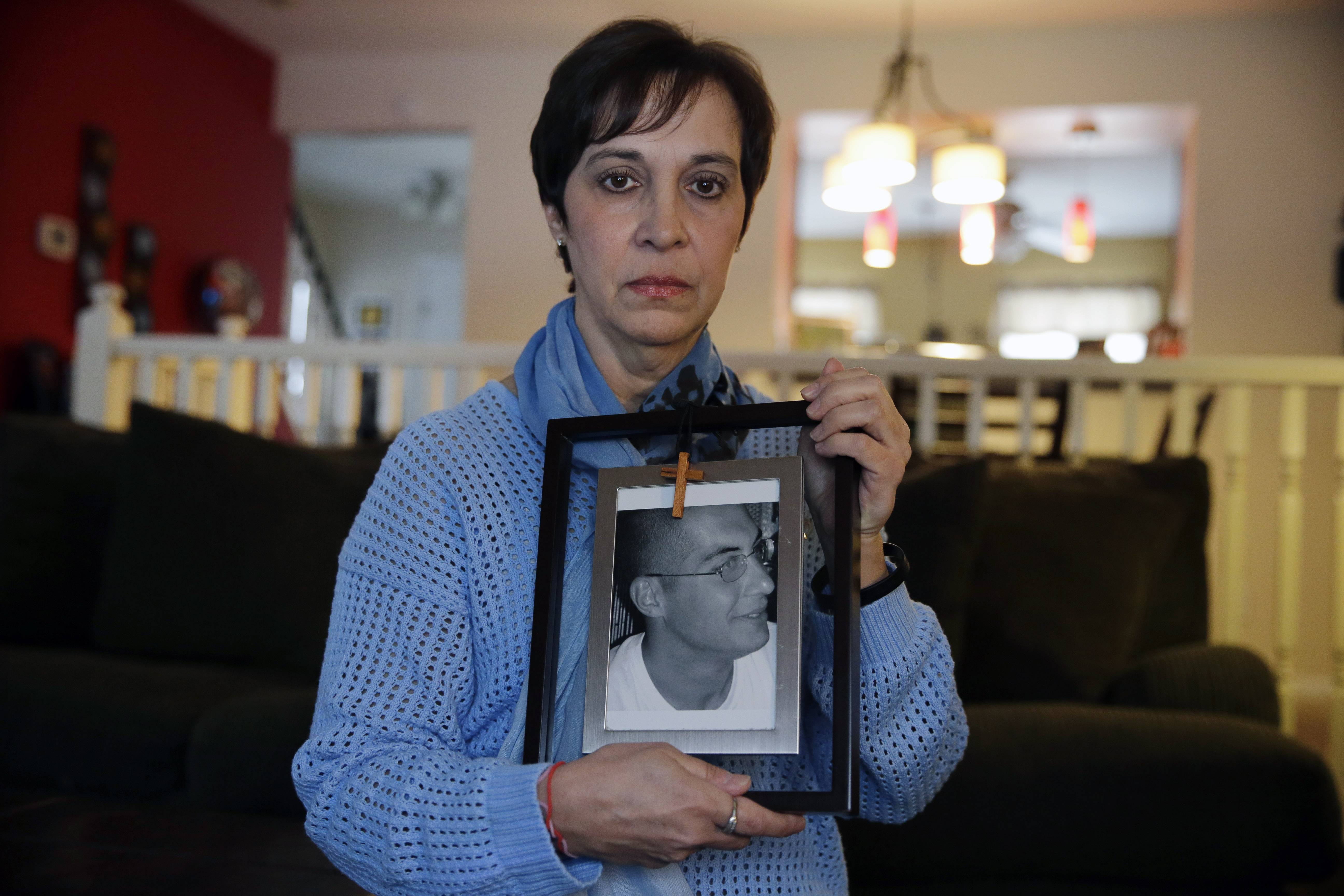 Patty DiRenzo holds a picture of her son, Salvatore Marchese, in her home in Blackwood, N.J. Salvatore died from a heroin overdose in 2010.