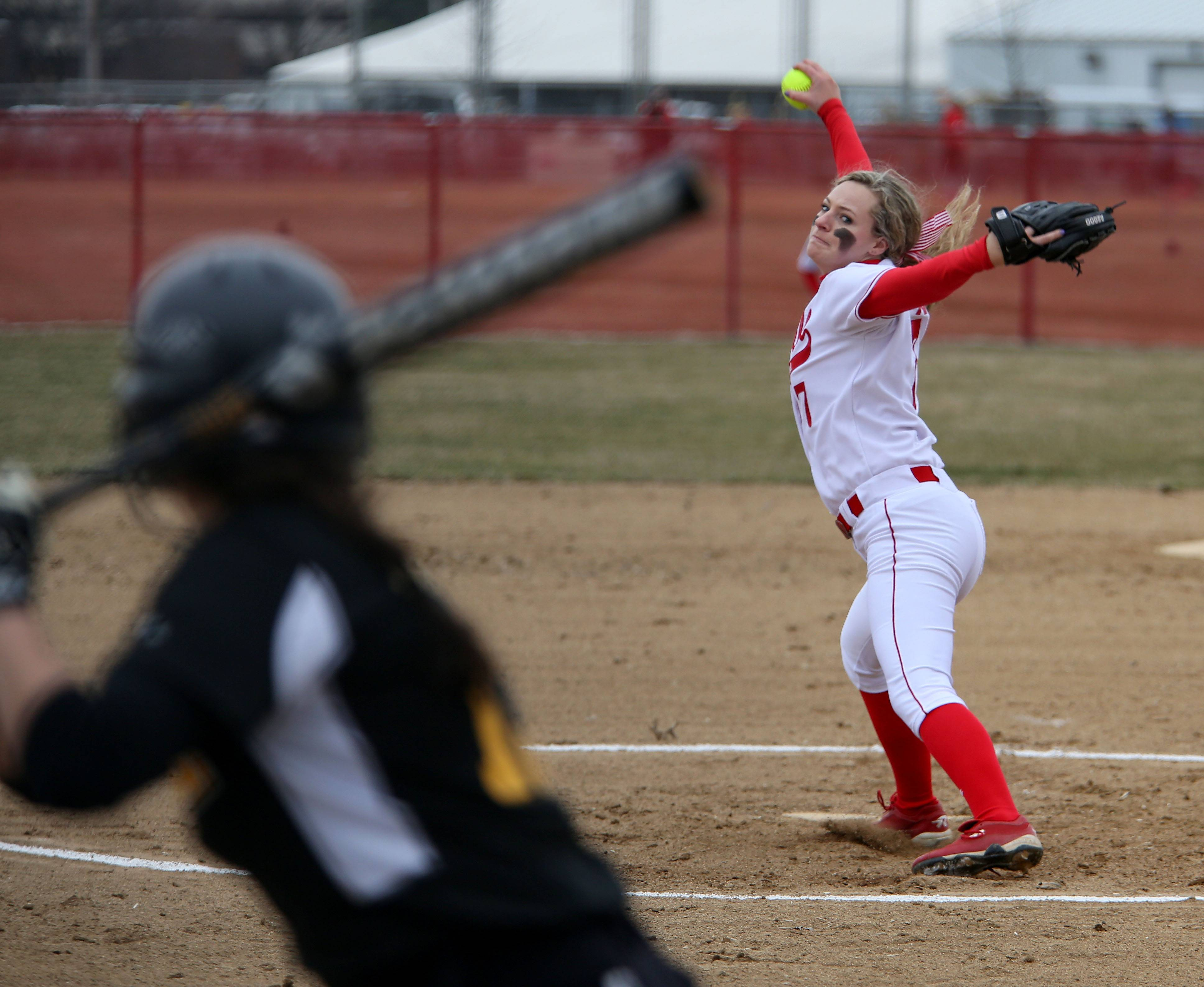 Naperviile Central's Keegan Hayes winds up her pitch against Hinsdale South during softball on Monday in Naperville.