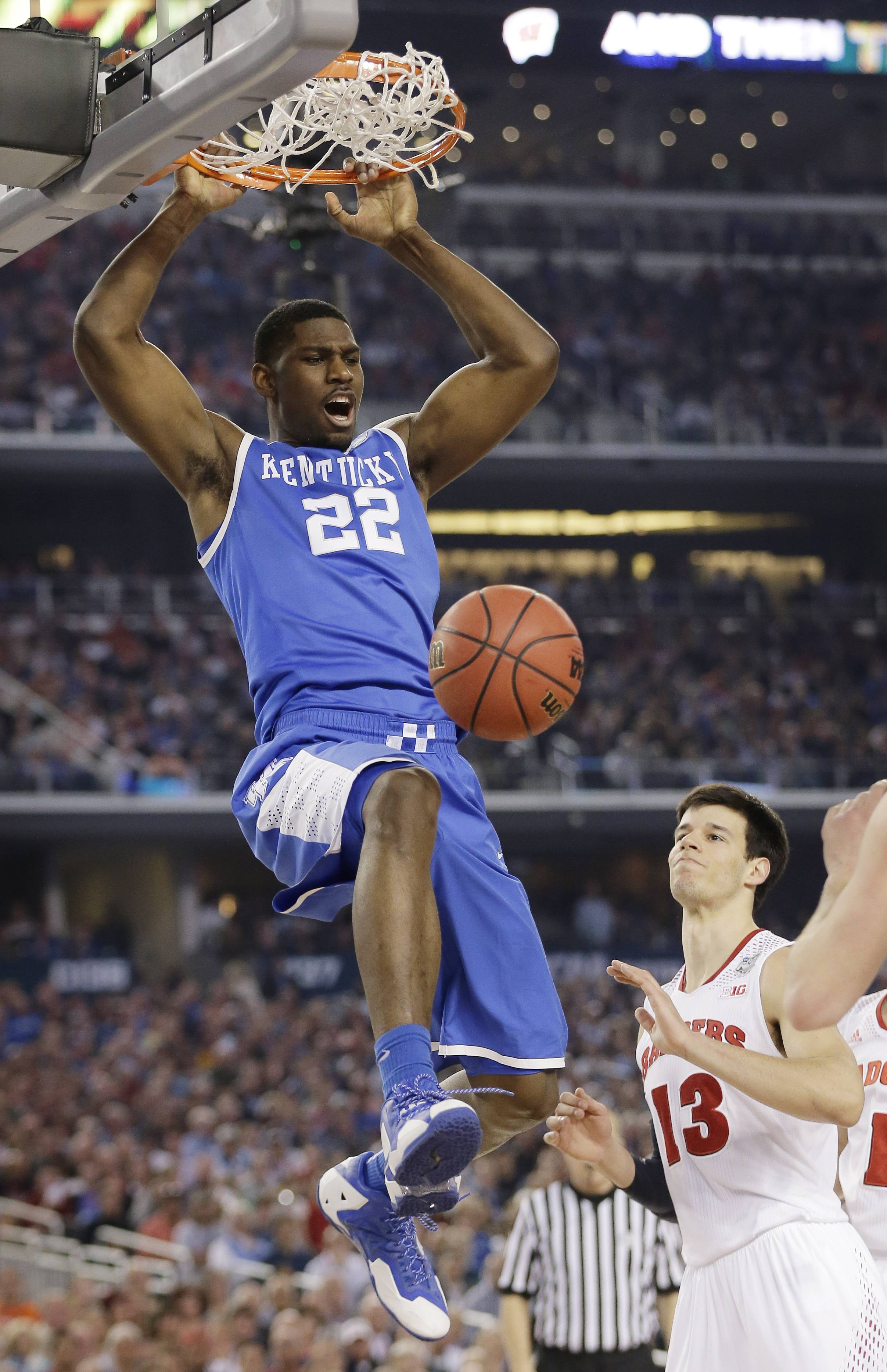 Kentucky forward Alex Poythress dunks the ball over Wisconsin forward Duje Dukan (13) during the first half of an NCAA Final Four tournament college basketball semifinal game Saturday, April 5, 2014, in Arlington, Texas.