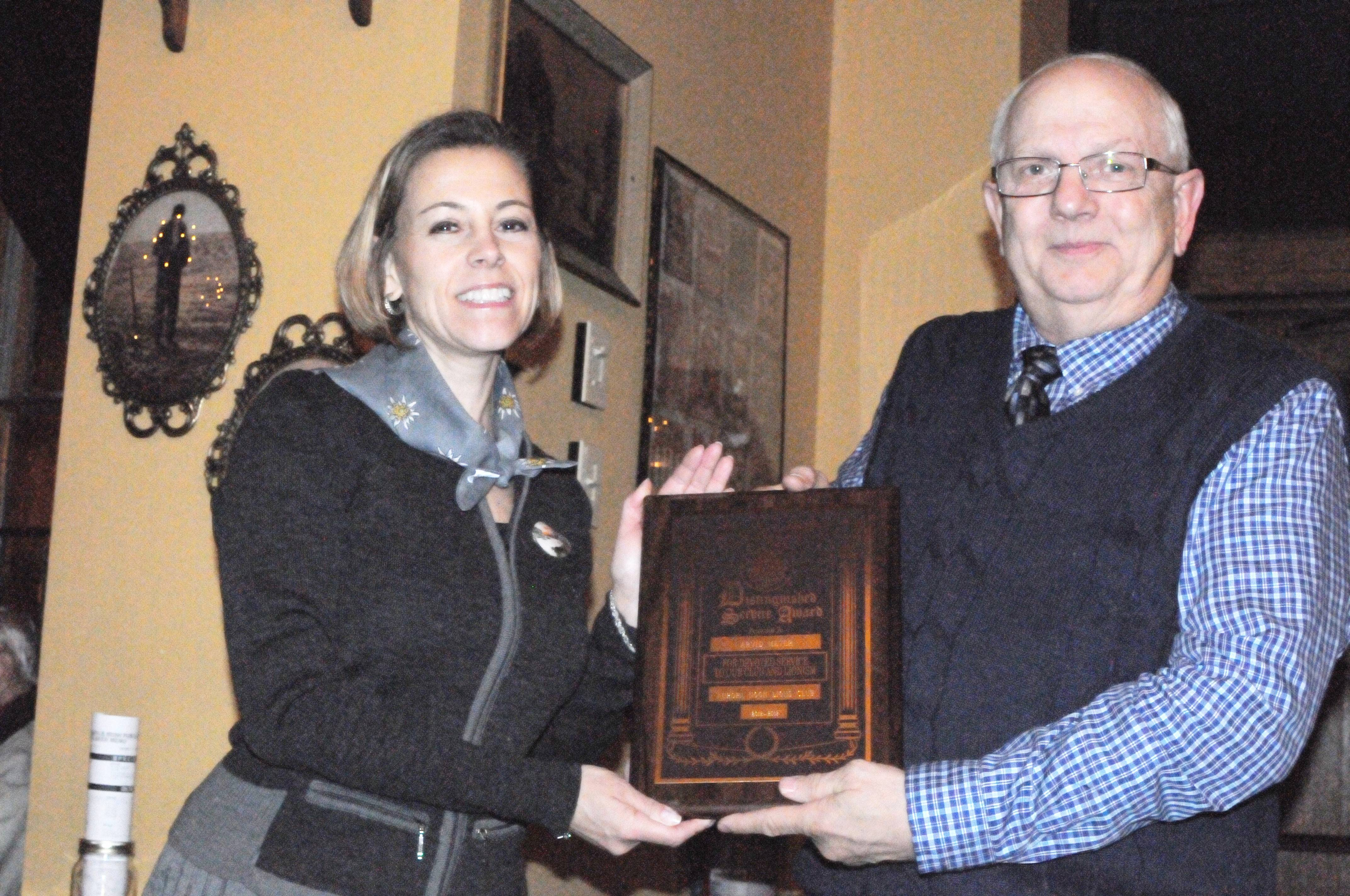 Arvid Meyer of Aurora, right, receives the Aurora Noon Lions Club's distinguished service award for 2012-2013 March 27 at Bally Doyle restaurant in Aurora. At left, Michele Needham of Plainfield, Noon Lions scholarship and service awards chairman, presents Meyer's award.