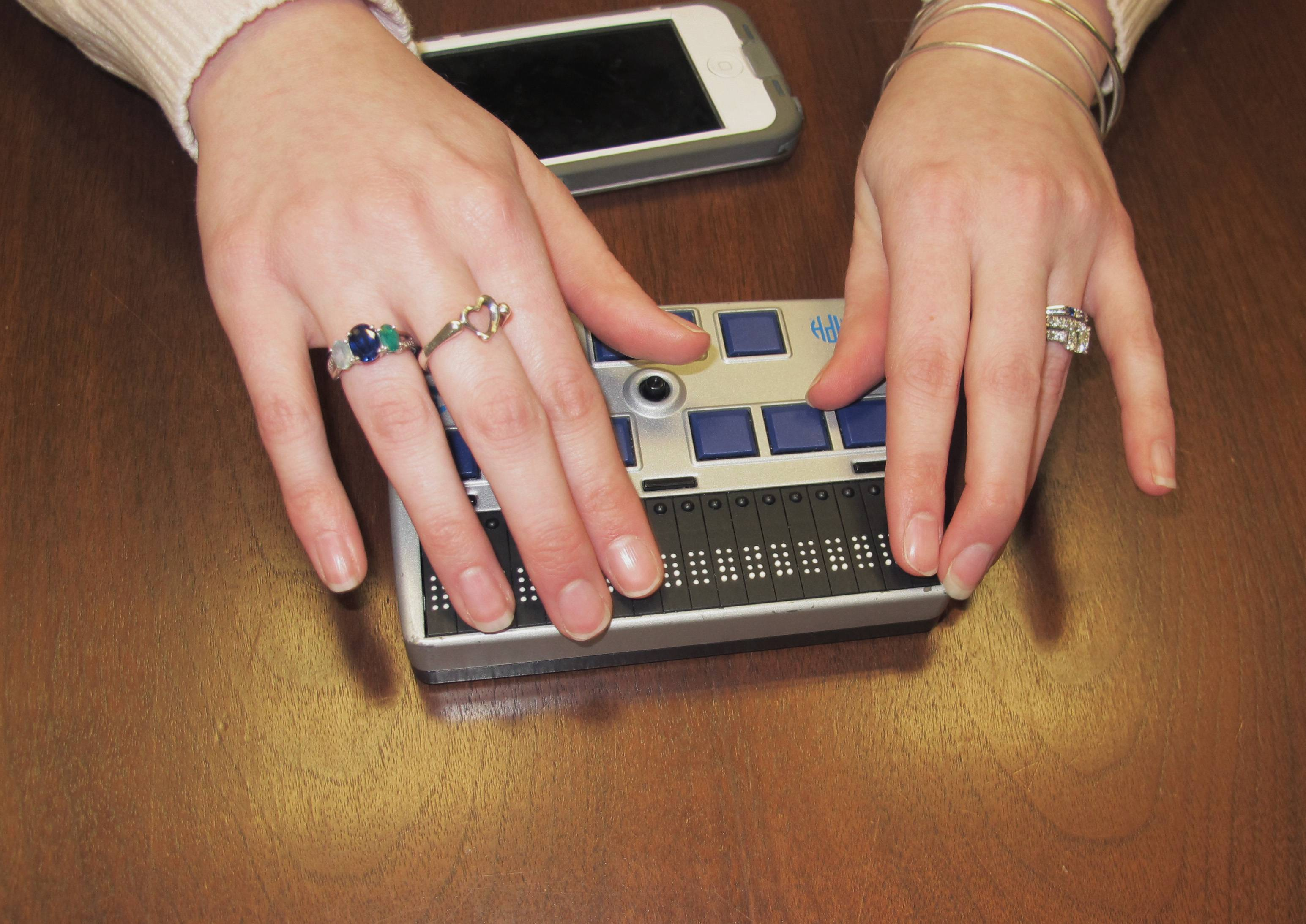 Megan Dausch, an instructor at the Helen Keller National Center, demonstrates the use of a Braille reader that helps blind clients access the Internet, in Sands Point, N.Y.