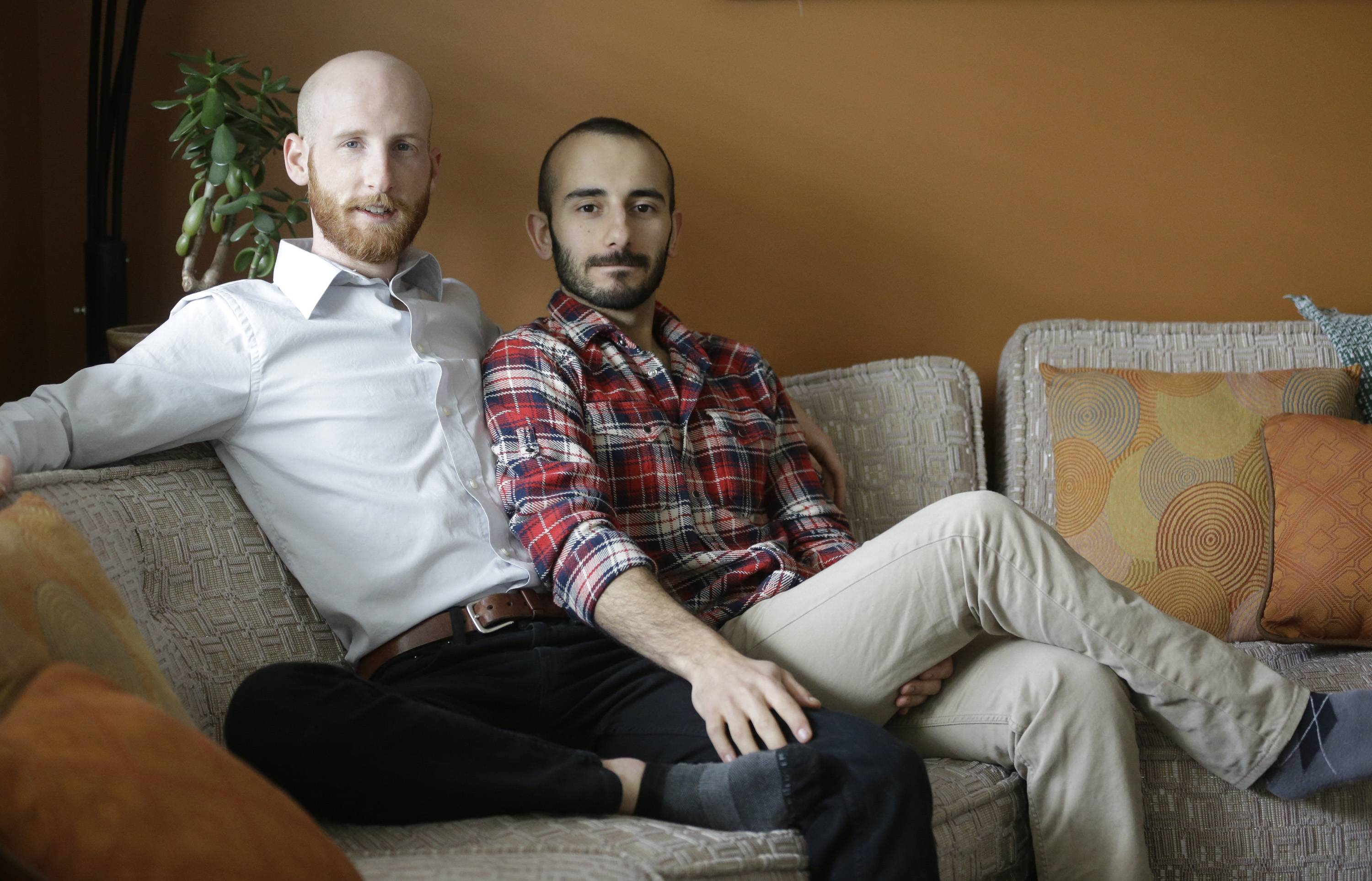 Derek Kitchen, left, and Moudi Sbeity have become the face of gay marriage in Utah. Kitchen and Sbeity were both raised in conservative religious families that shun gays, Kitchen in a Mormon home in Utah and Sbeity in a Muslim family in Lebanon.