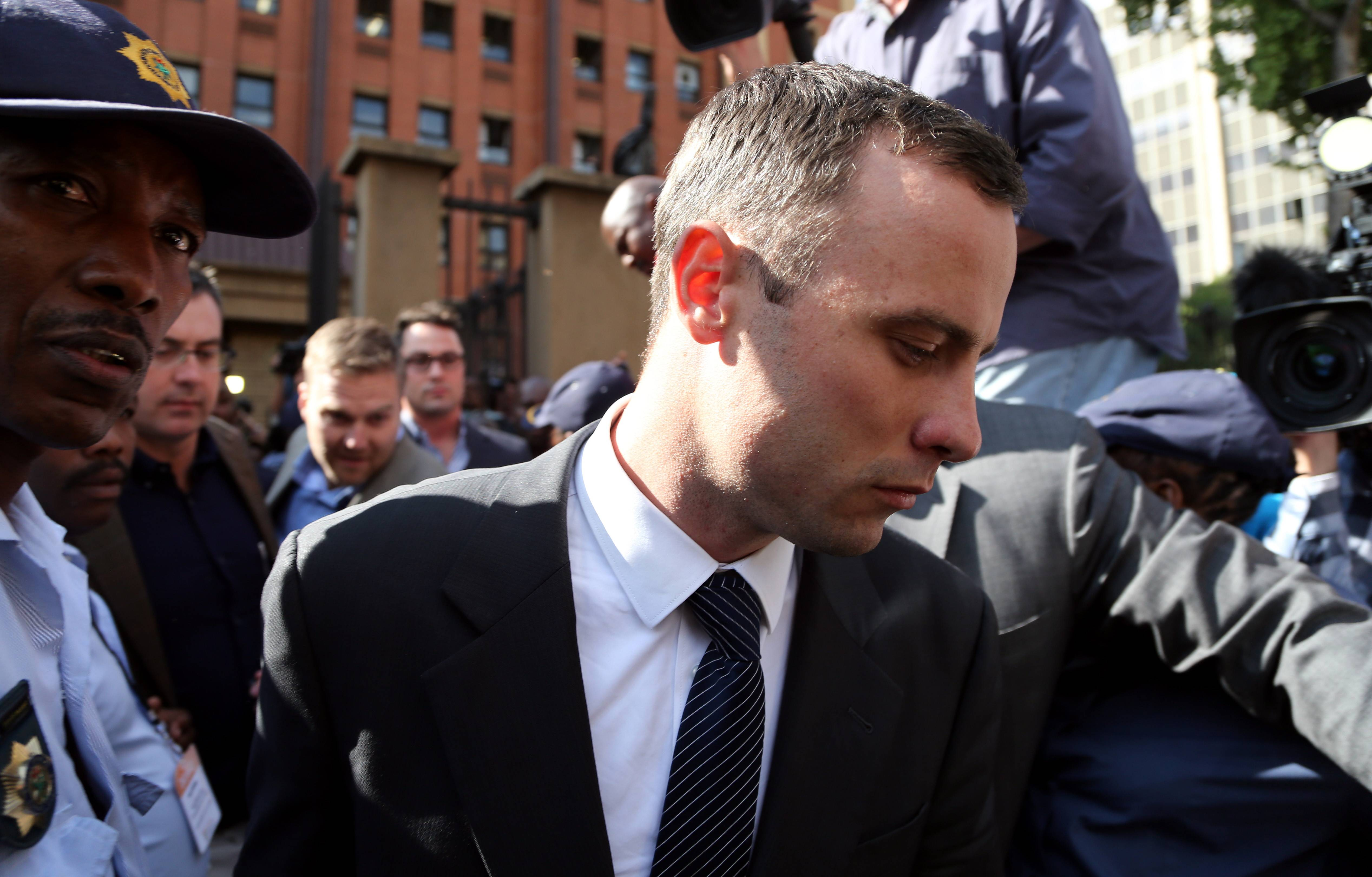Oscar Pistorius, leaves the high court in Pretoria, South Africa, Tuesday. He is charged with murder for the shooting death of his girlfriend, Reeva Steenkamp, in 2013.