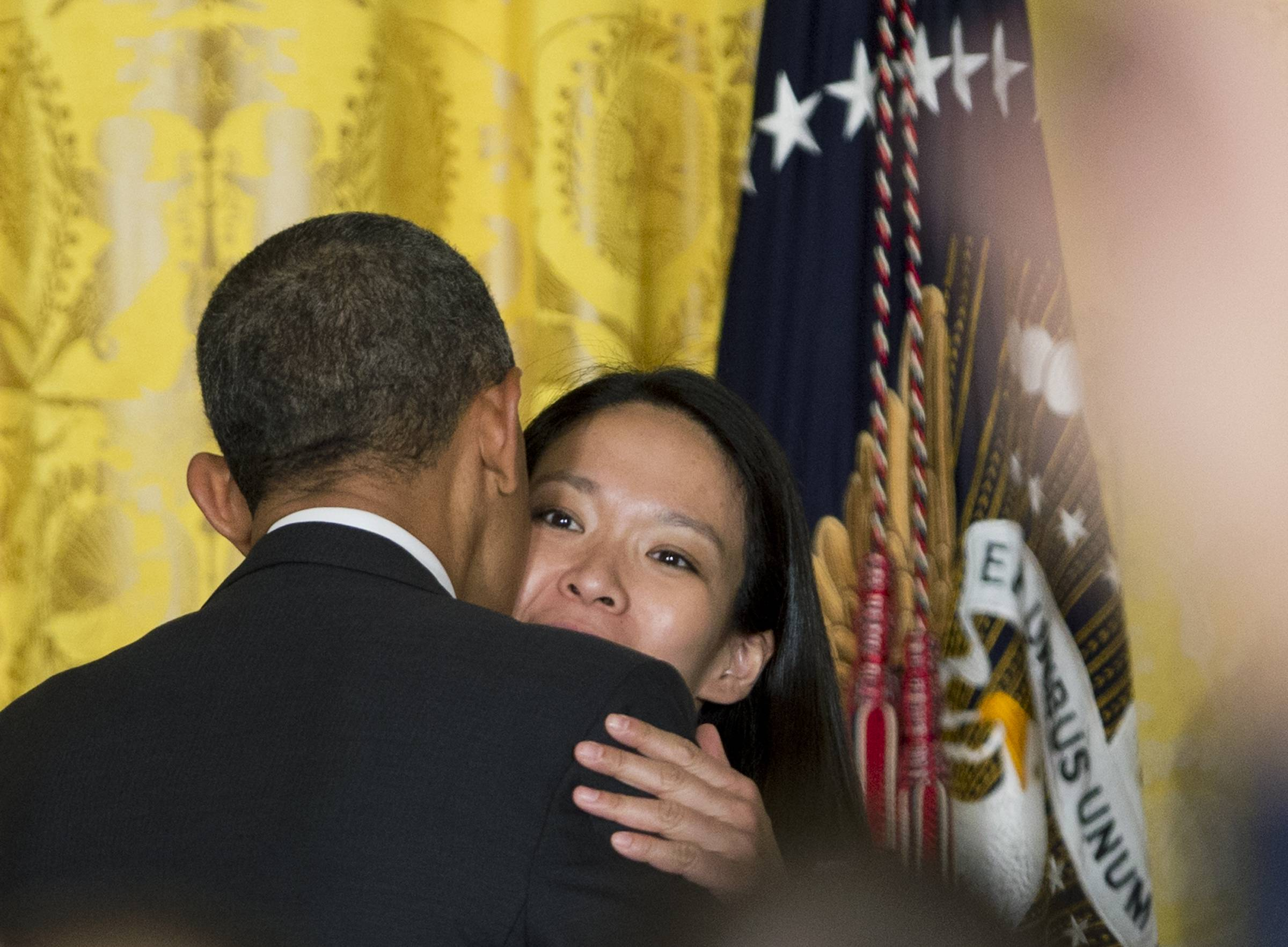 President Barack Obama gives Julie Chu, right, of Fairfield, Conn., a member of the 2014 U.S. Women's Olympic Ice Hockey team, a kiss during a ceremony welcoming members of the United States teams and delegations from the 2014 Winter Olympic and Paralympic Winter Games to the White House last week.