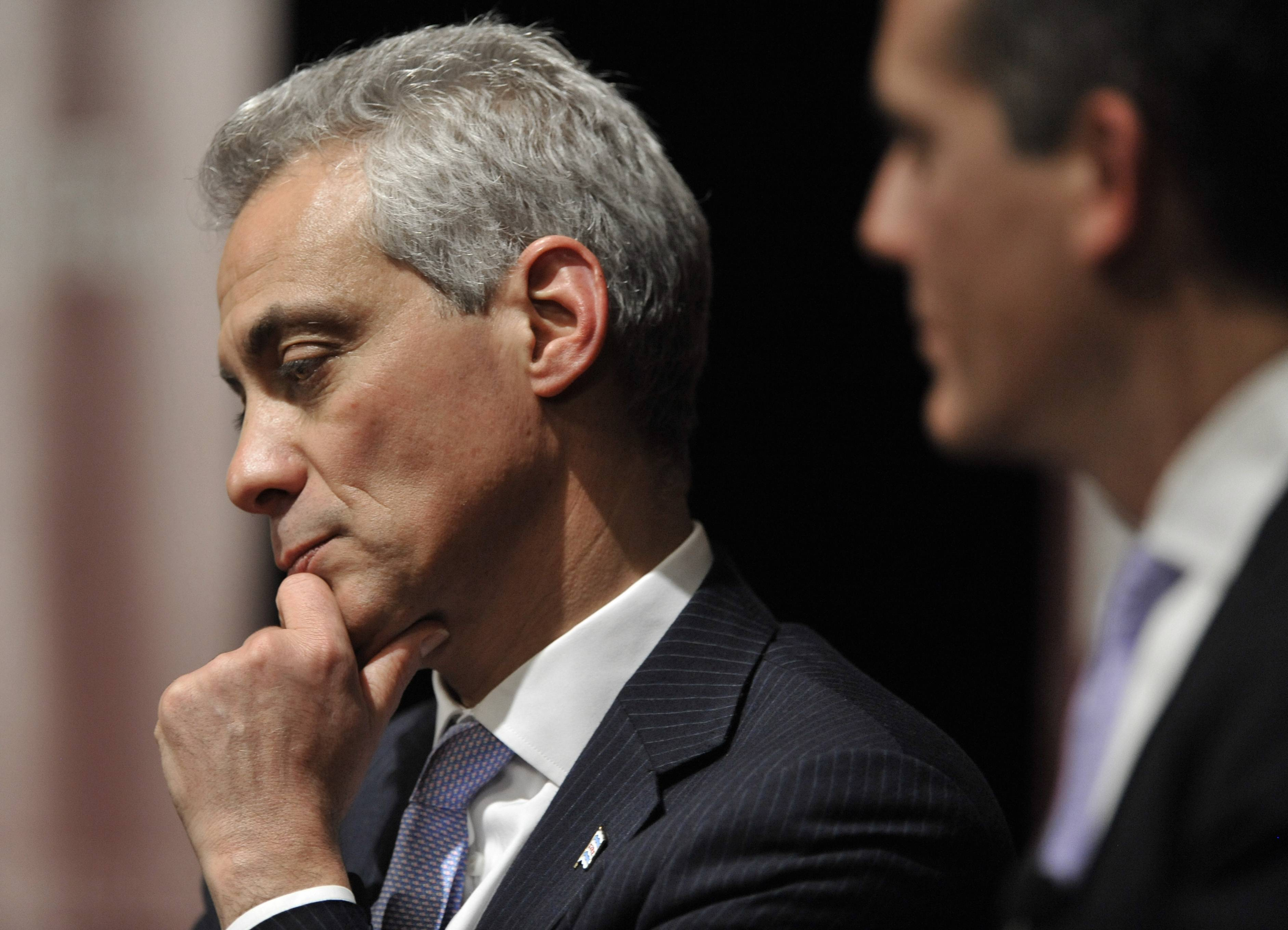 Chicago Mayor Rahm Emanuel, left, and Los Angeles Mayor Eric Garcetti listen during a March panel discussion about the issues facing the nation's big cities at the University of Chicago.