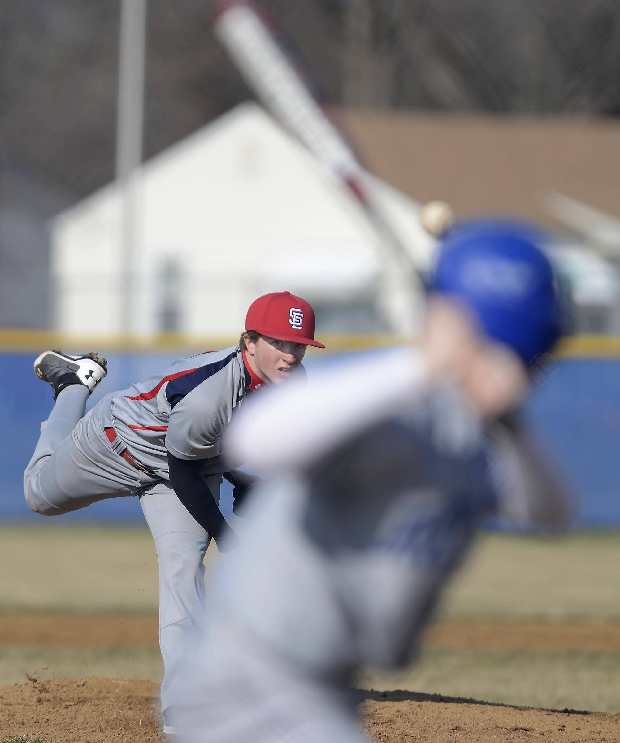 South Elgin's Tyler Brown throws to Larkin's Robert Bond in the first inning Tuesday in Elgin.