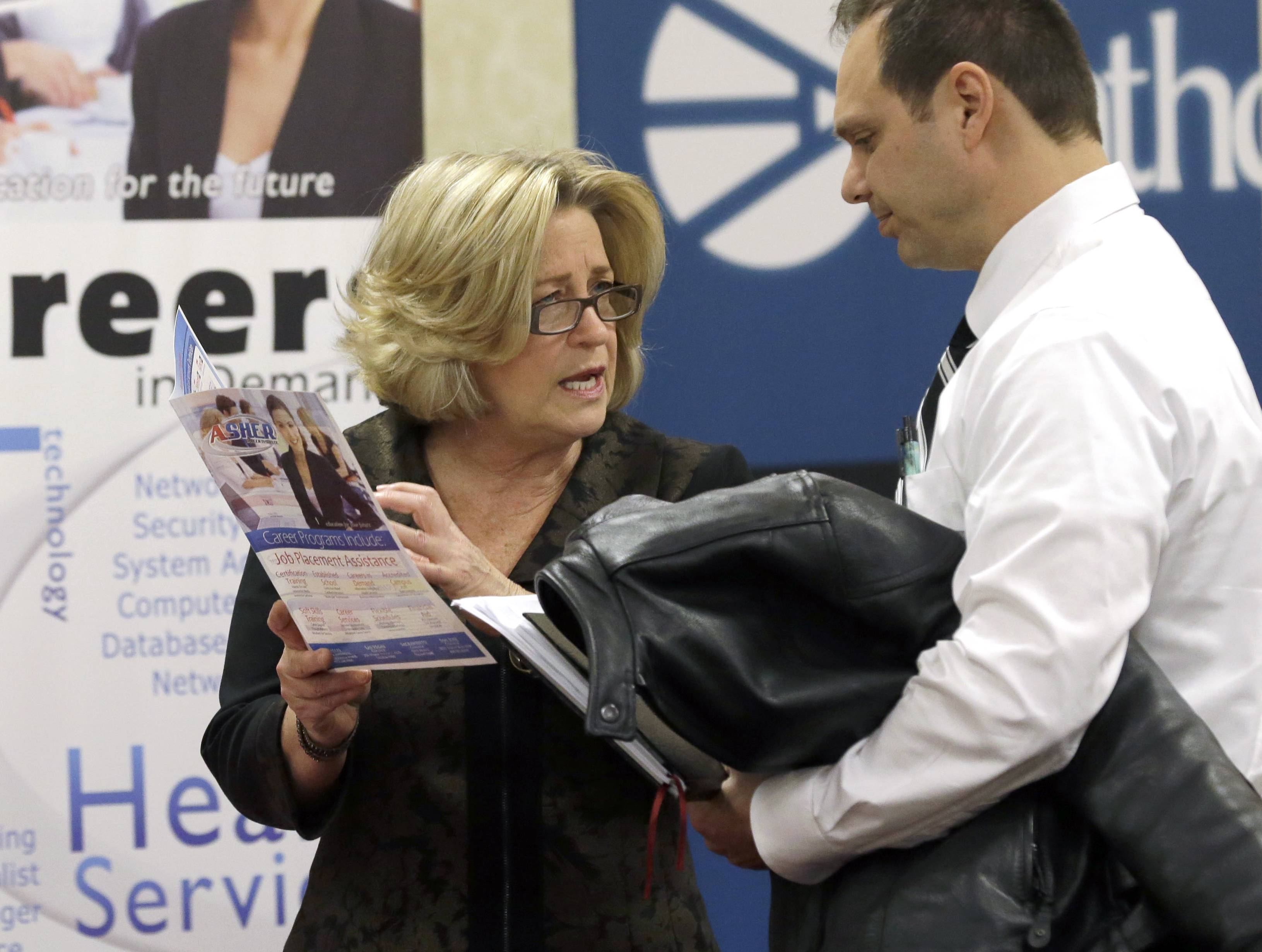 Recruiter Valera Kulow, left, speaks with job seeker Leonardo Vitiello during a career fair in Dallas. U.S. employers posted more job openings in February, a sign that hiring will likely improve in the months ahead.