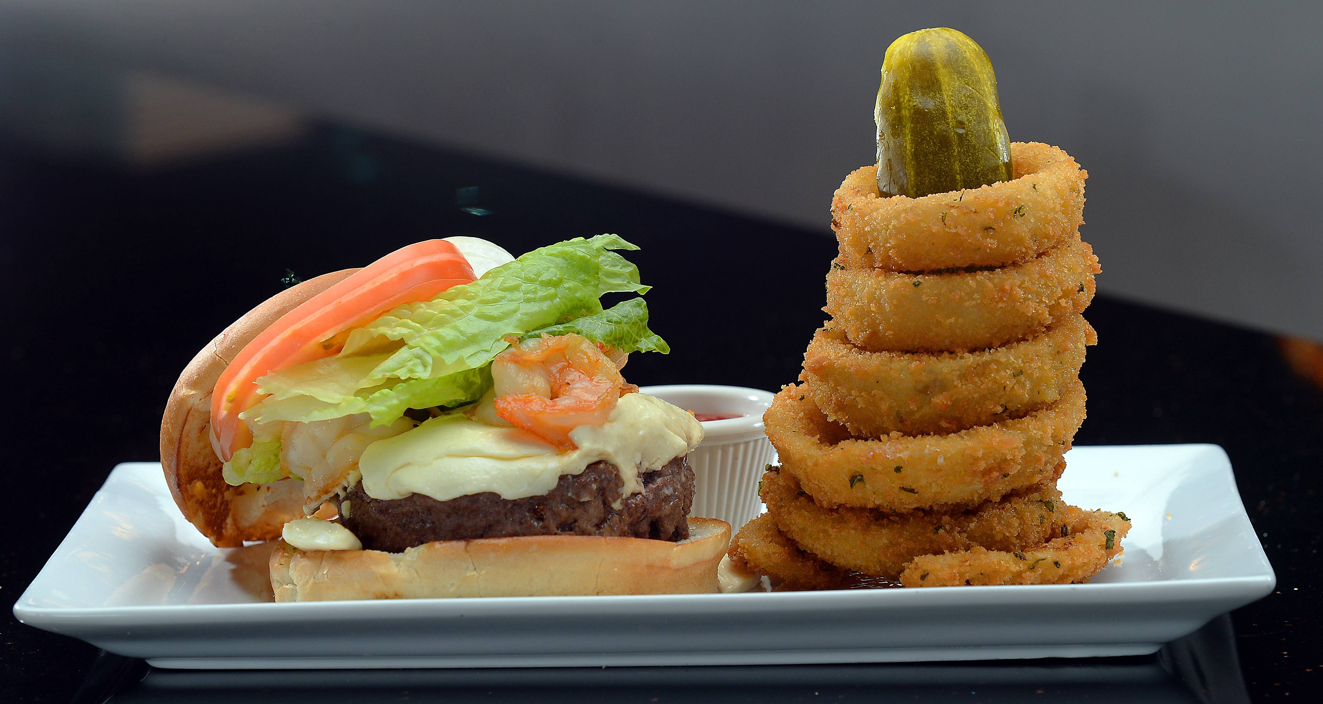 Chef Cristiano Bassani serves gourmet burgers and pizza at Big Chef Burgers in Schaumburg.