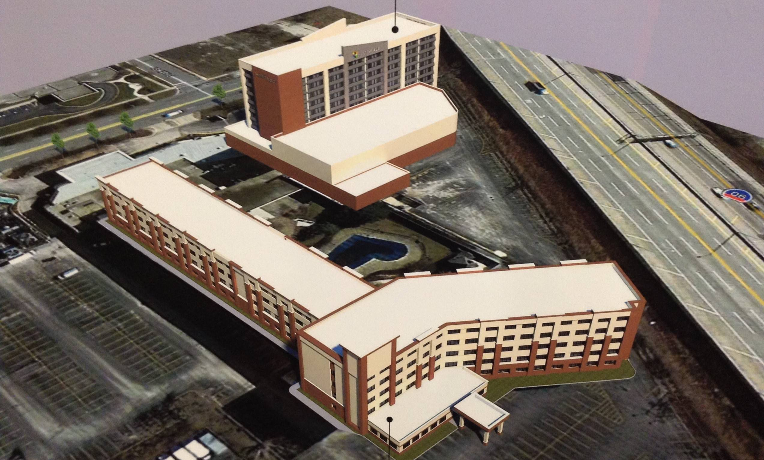 "This is a photo of a sketch that shows proposed renovations to the shuttered Wyndham O'Hare Hotel in Rosemont. Developers are planning to open a 200-room Hyatt Place Hotel and a separate ""select service"" hotel of between 180 and 200 rooms."