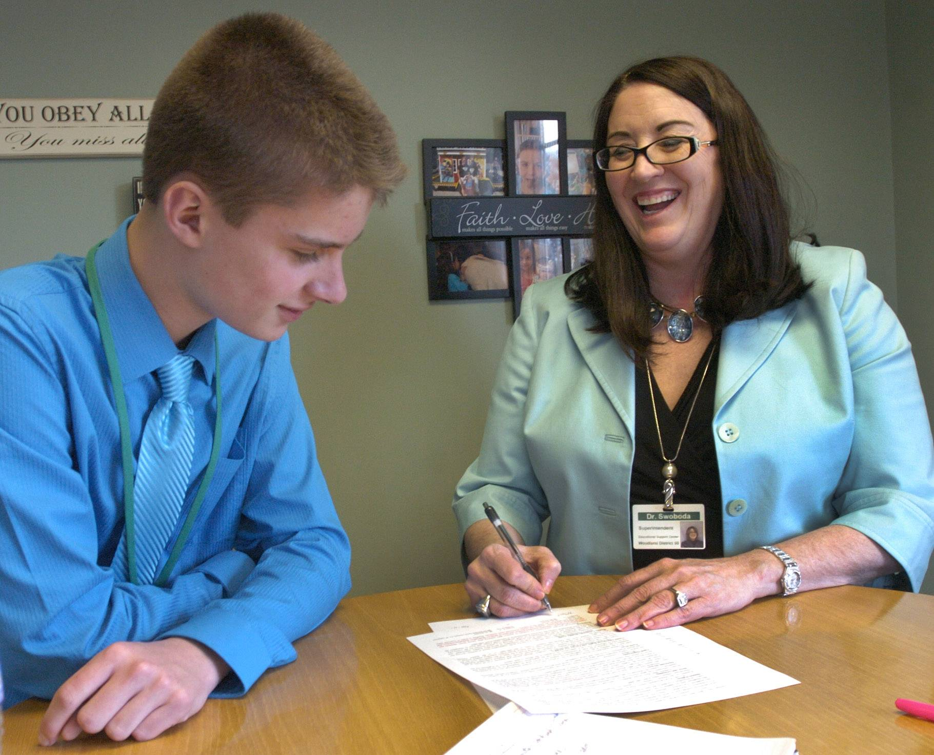 Woodland Middle School seventh-grader Bradley Wilinski goes over the ground rules for serving as Superintendent for a Day on Tuesday with the real Woodland Elementary District 50 superintendent, Joy Swoboda.