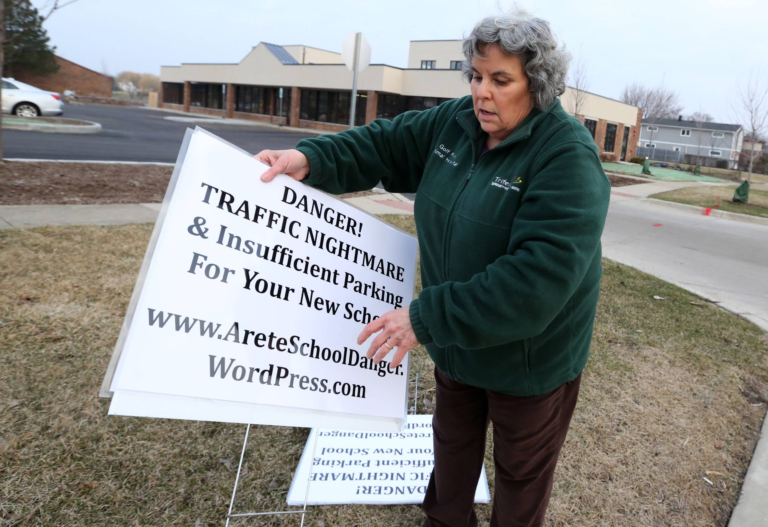 Karen Hailpern of unincorporated Cook County talks Tuesday morning about how she and others are placing signs around Montessori School of North Hoffman and handing out fliers about the owner's plans to add another location at a site picketers don't approve of.