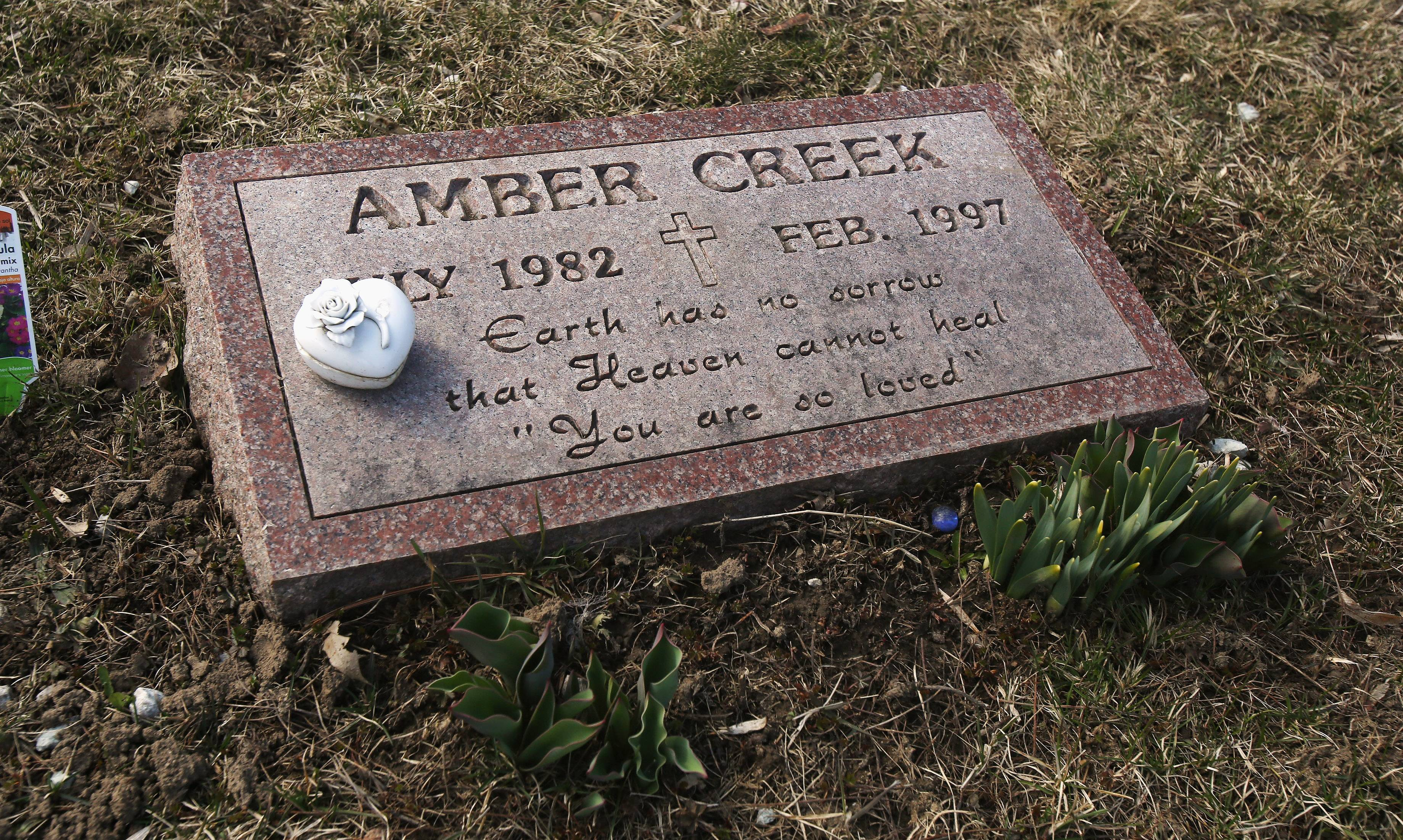 The gravesite of Amber Creek at Holy Family Cemetery near Racine. Officials announced Tuesday that after 17 years, they have charged a Palatine man with Amber's murder.