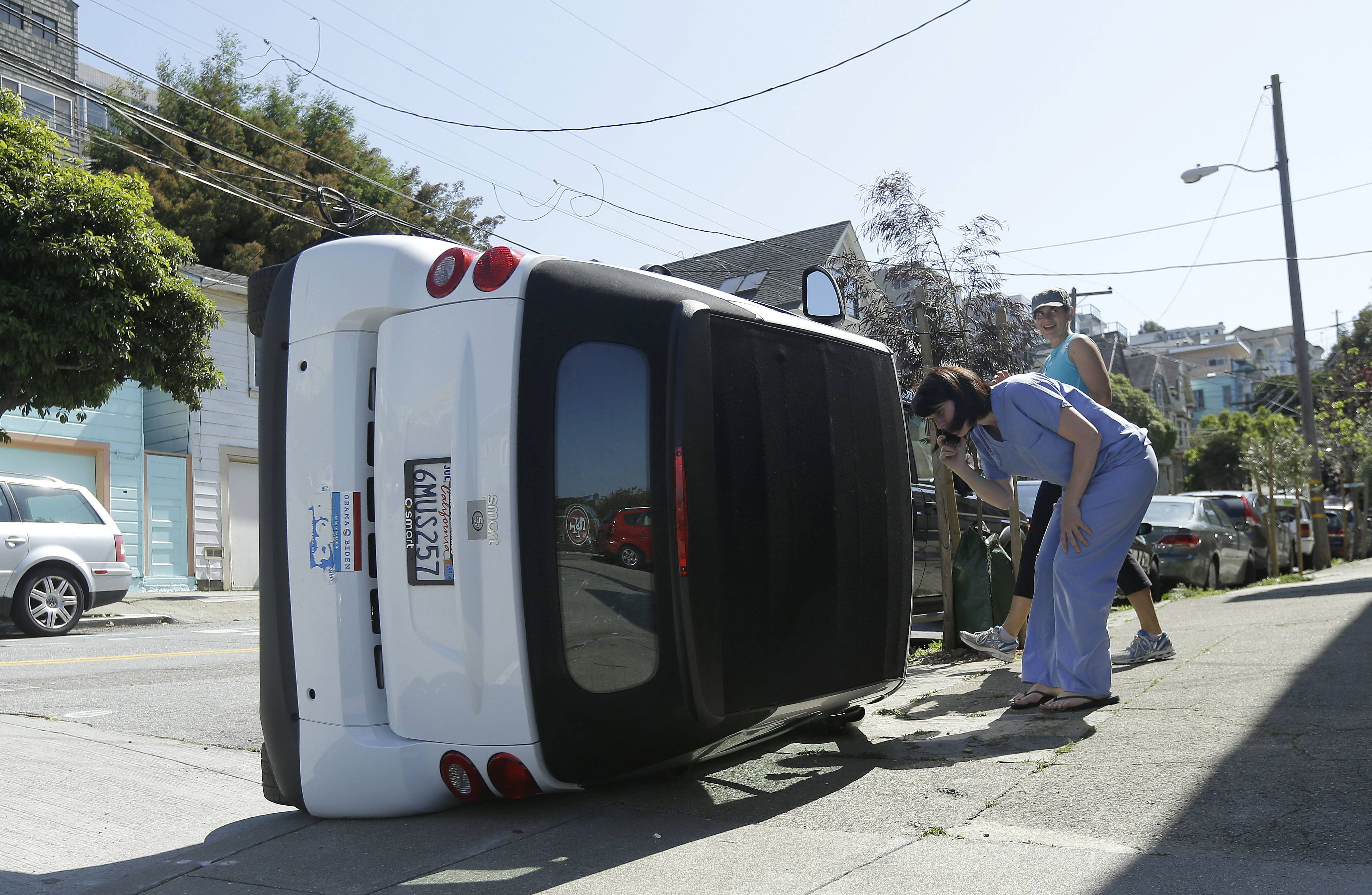 Police in San Francisco are investigating why four Smart cars were flipped over during an apparent early morning vandalism spree.