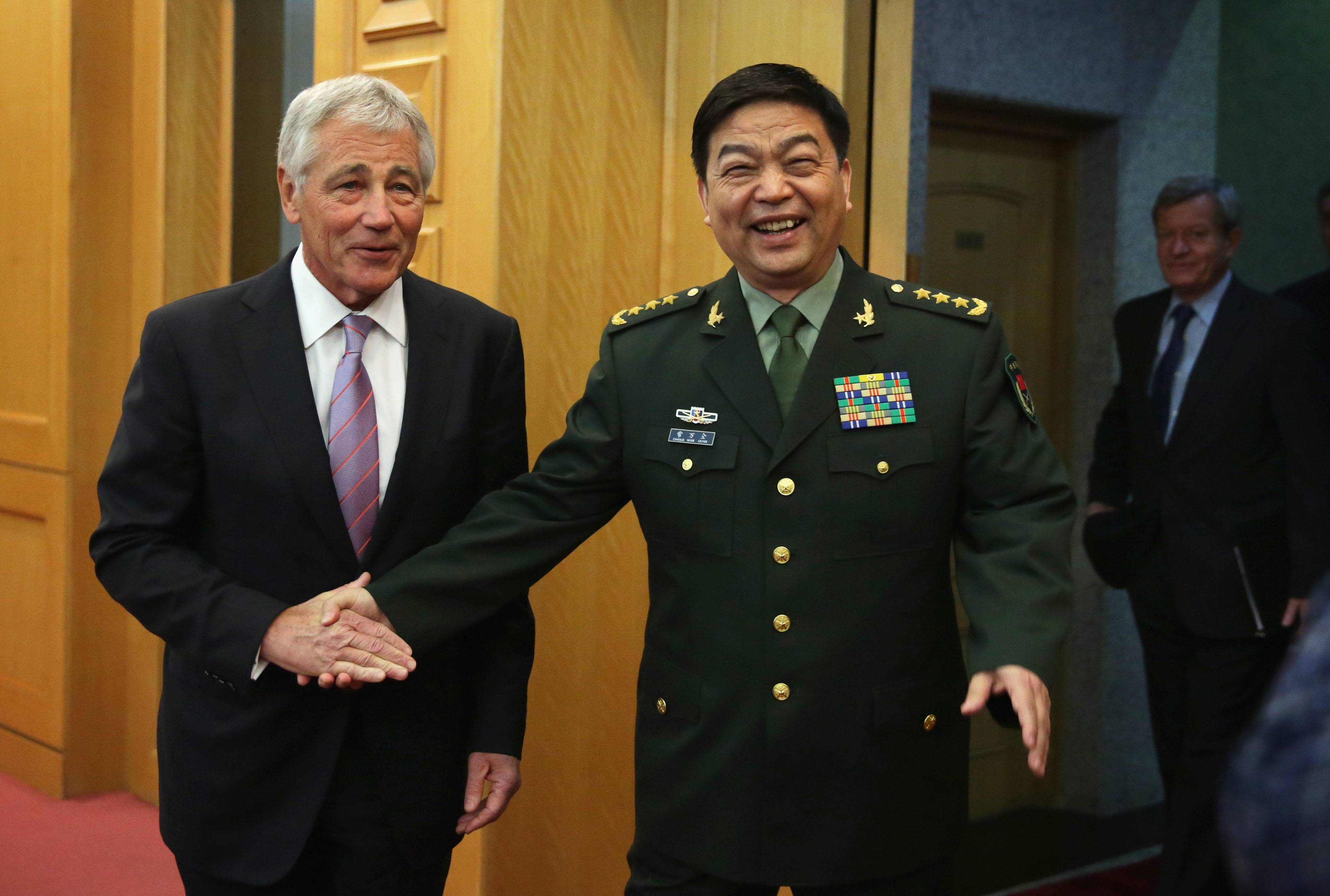Defense Secretary Chuck Hagel shakes hands with Chinese Minister of Defense Chang Wanquan prior to their meeting at the Chinese Defense Ministry headquarters in Beijing, Tuesday, April 8, 2014.