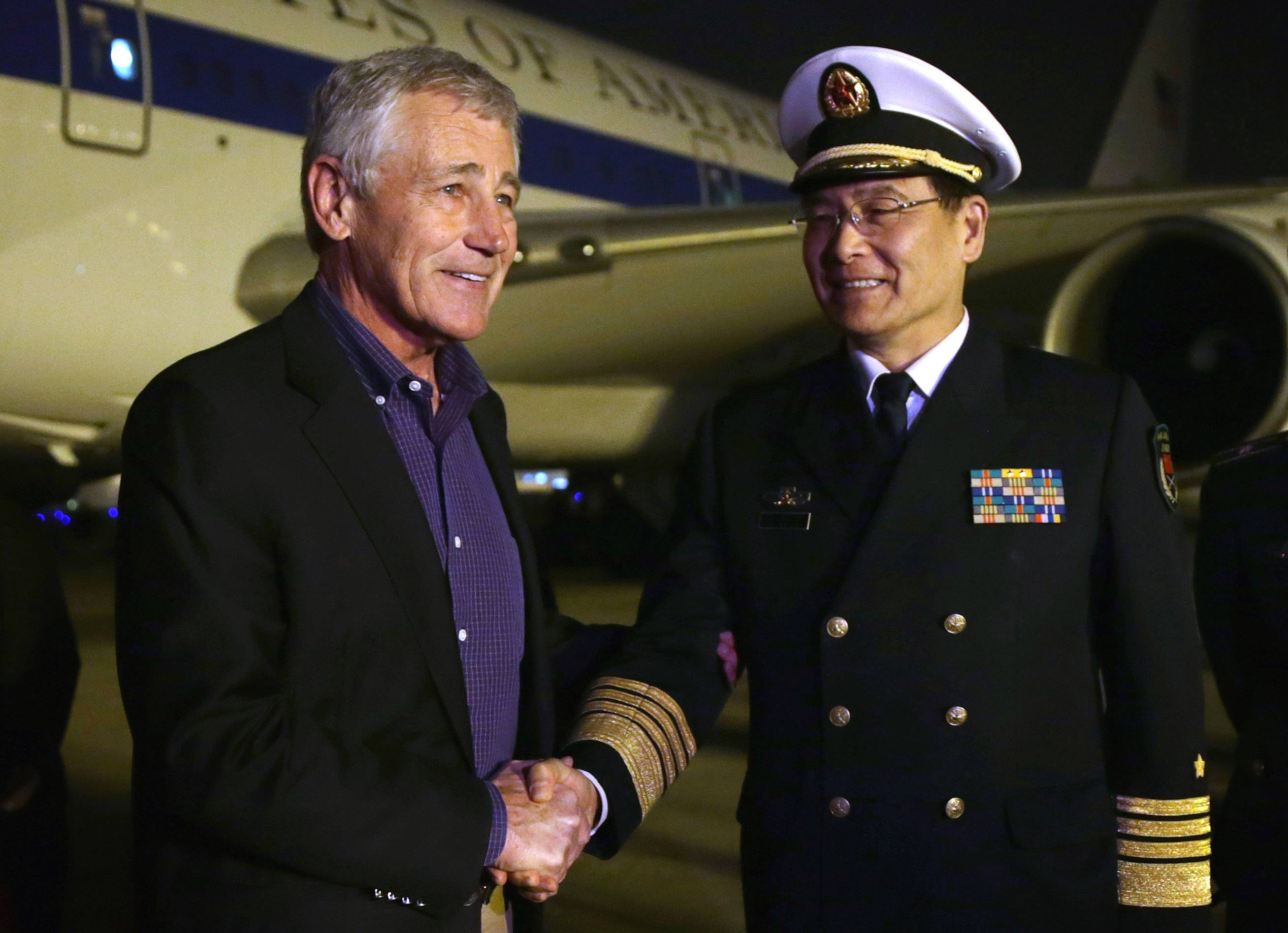 Defense Secretary Chuck Hagel is welcomed by Sun Jianguo, Deputy Chief of General Staff of the Chinese People's Liberation Army, upon his arrival at Beijing International in Beijing, Monday, Airport April 7, 2014. Hagel arrived in Beijing Monday after a stop in Japan, where he told reporters that China must be more open about its military buildup and better respect its neighbors _ a pointed reference to Beijing's ongoing territorial dispute with Japan and others over remote islands in the East China Sea.