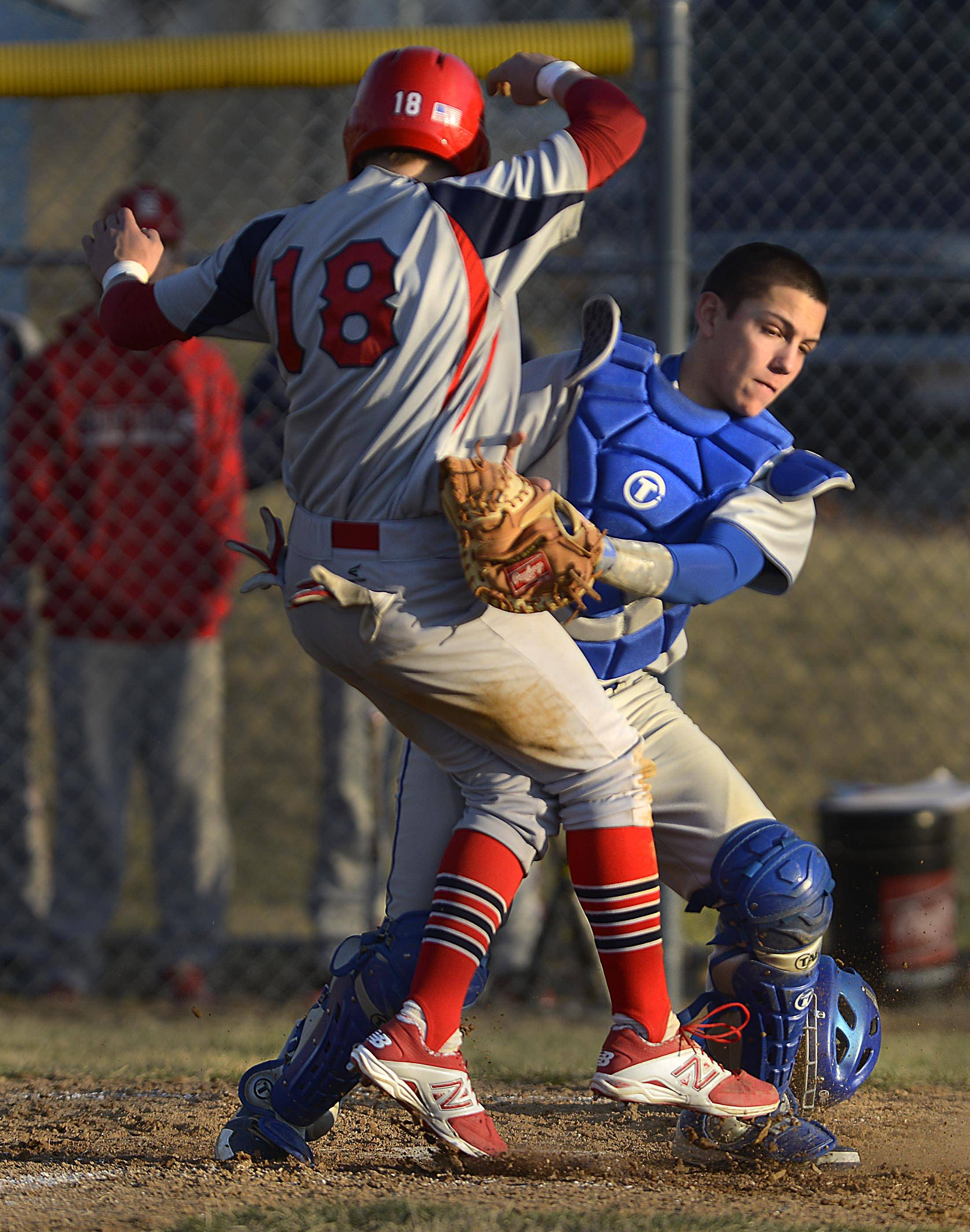 Larkin catcher Dan Lenz tags South Elgin's Nick Menken at the plate on a throw from left fielder Robert Bond for the third out of the seventh inning Tuesday in Elgin.