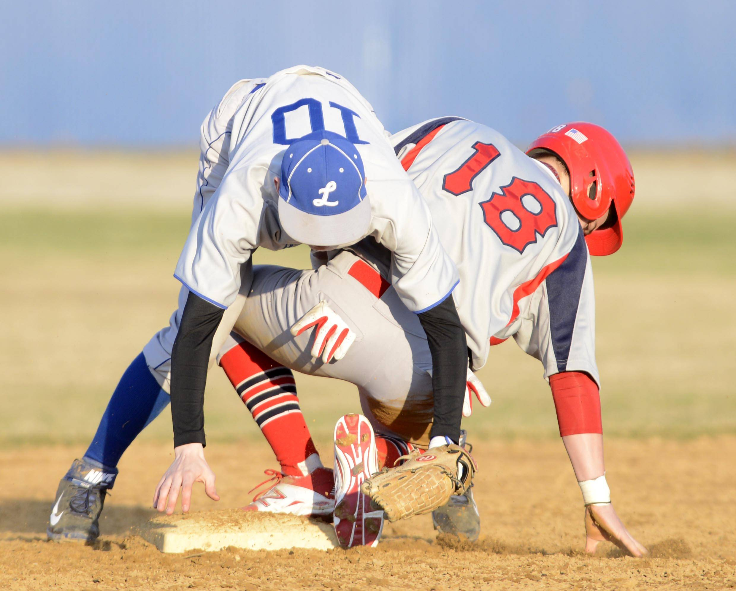 South Elgin's Nick Menken is safe at second as Larkin's Zach Edgar is late with the tag Tuesday in Elgin.