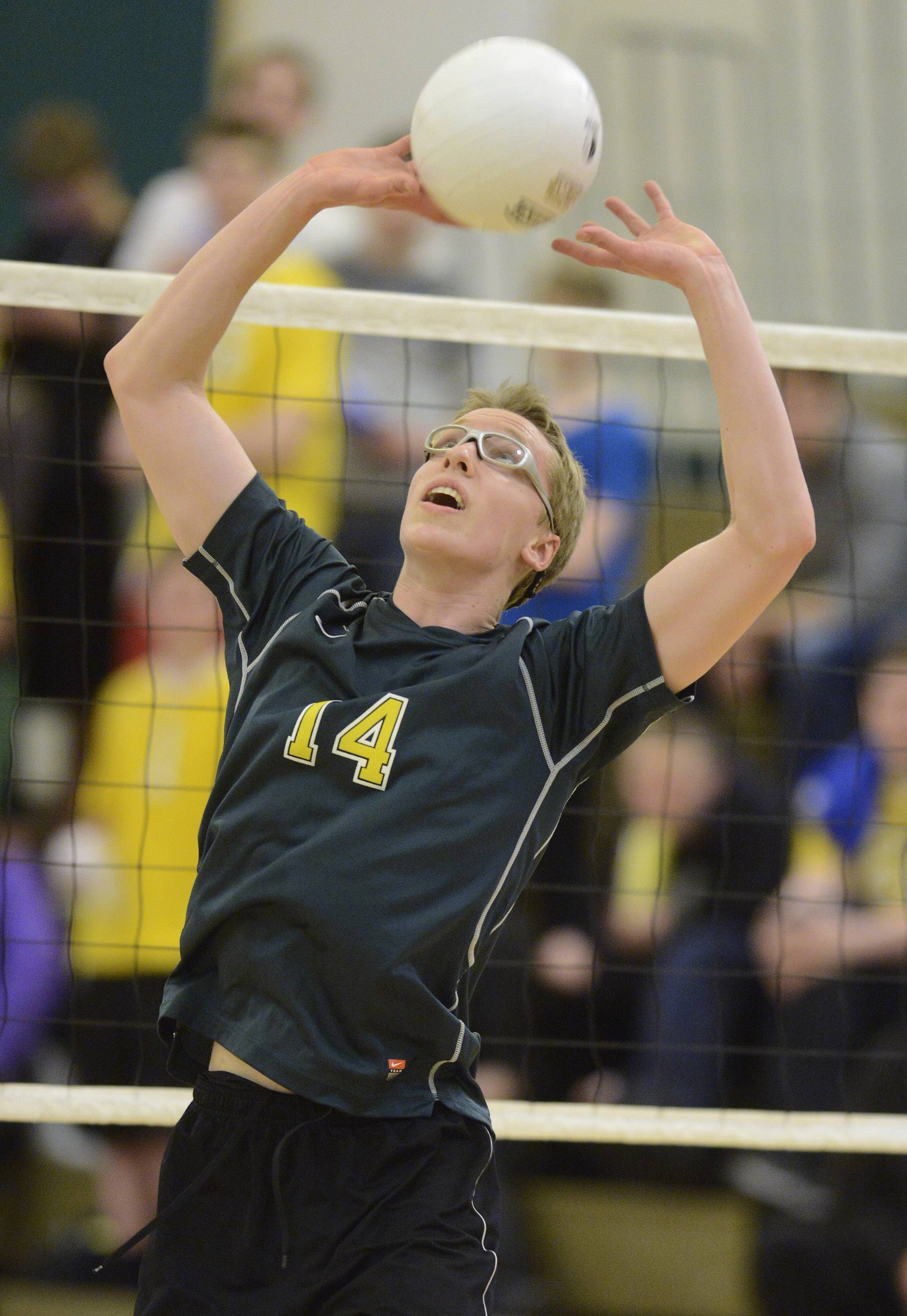 Elk Grove's Raymond Kraus set the ball during Tuesday's match with visiting Prospect.