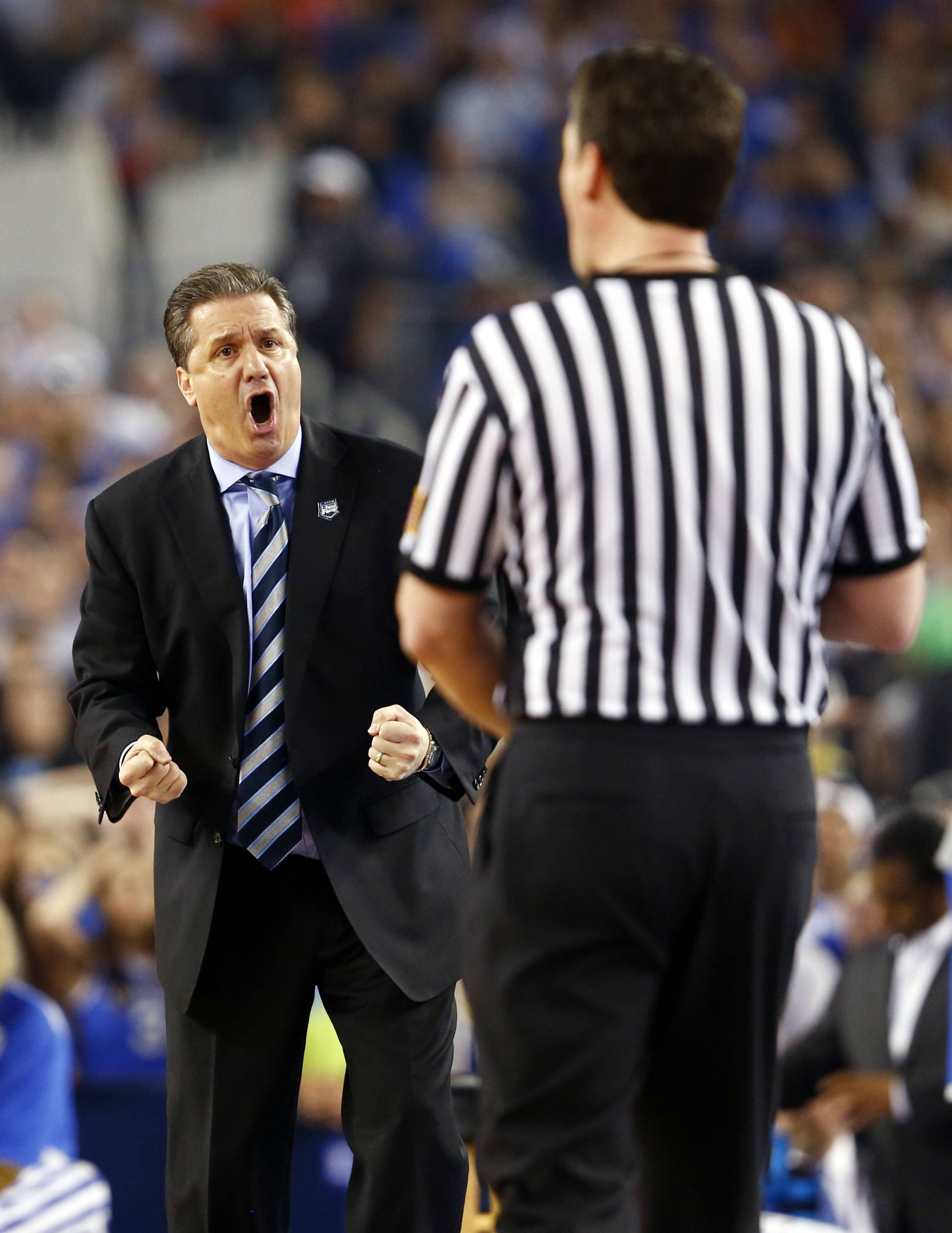 Kentucky head coach John Calipari argues with an official during the second half of the NCAA title game Monday at AT&T Stadium in Arlington, Texas.