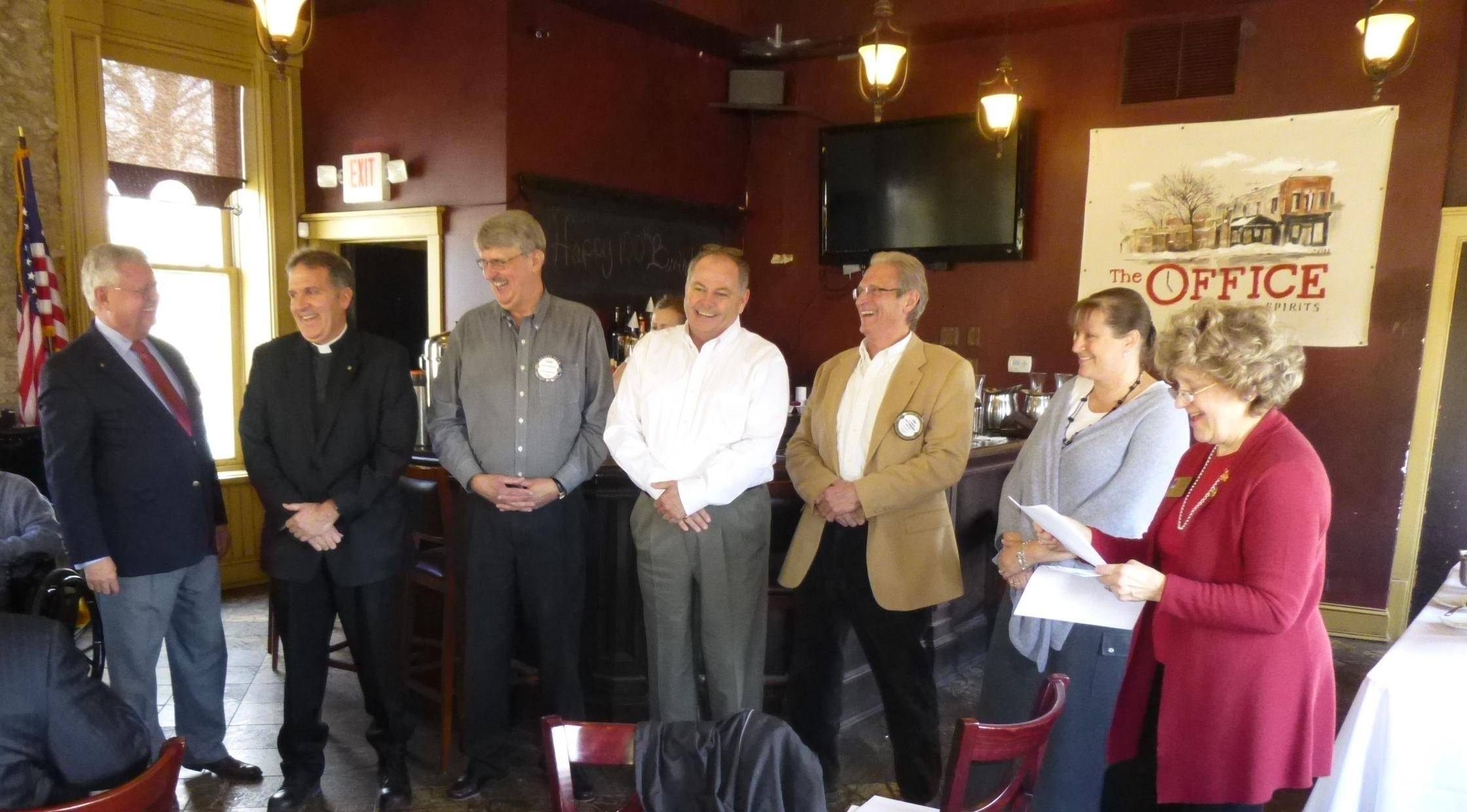 Rotary District Governor Elect Ellen Young, right, inducts three new members to the Rotary Club of St. Charles with Bob Brown, left, the Rev. David Peck, David McNamara, Tony Hyler, Guy Bellaver and Holly Cabel.