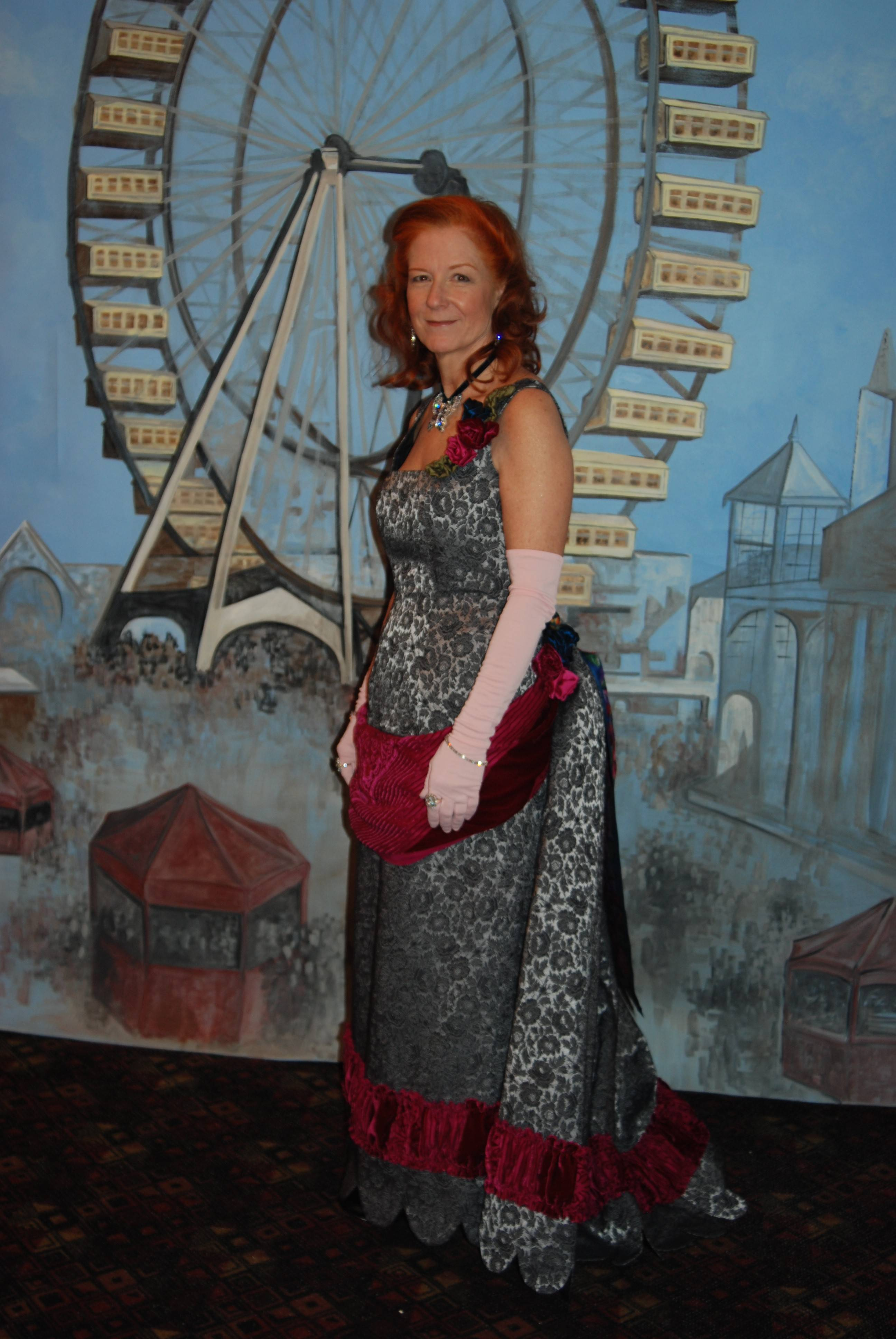 Paula Zoern Loga of Mount Prospect poses in front of the Ferris wheel backdrop, wearing the costume she created for the evening. The backdrop was hand-painted by Donna Koda of Elegant Accents, a Mount Prospect-based trompe l'oeil painting firm.