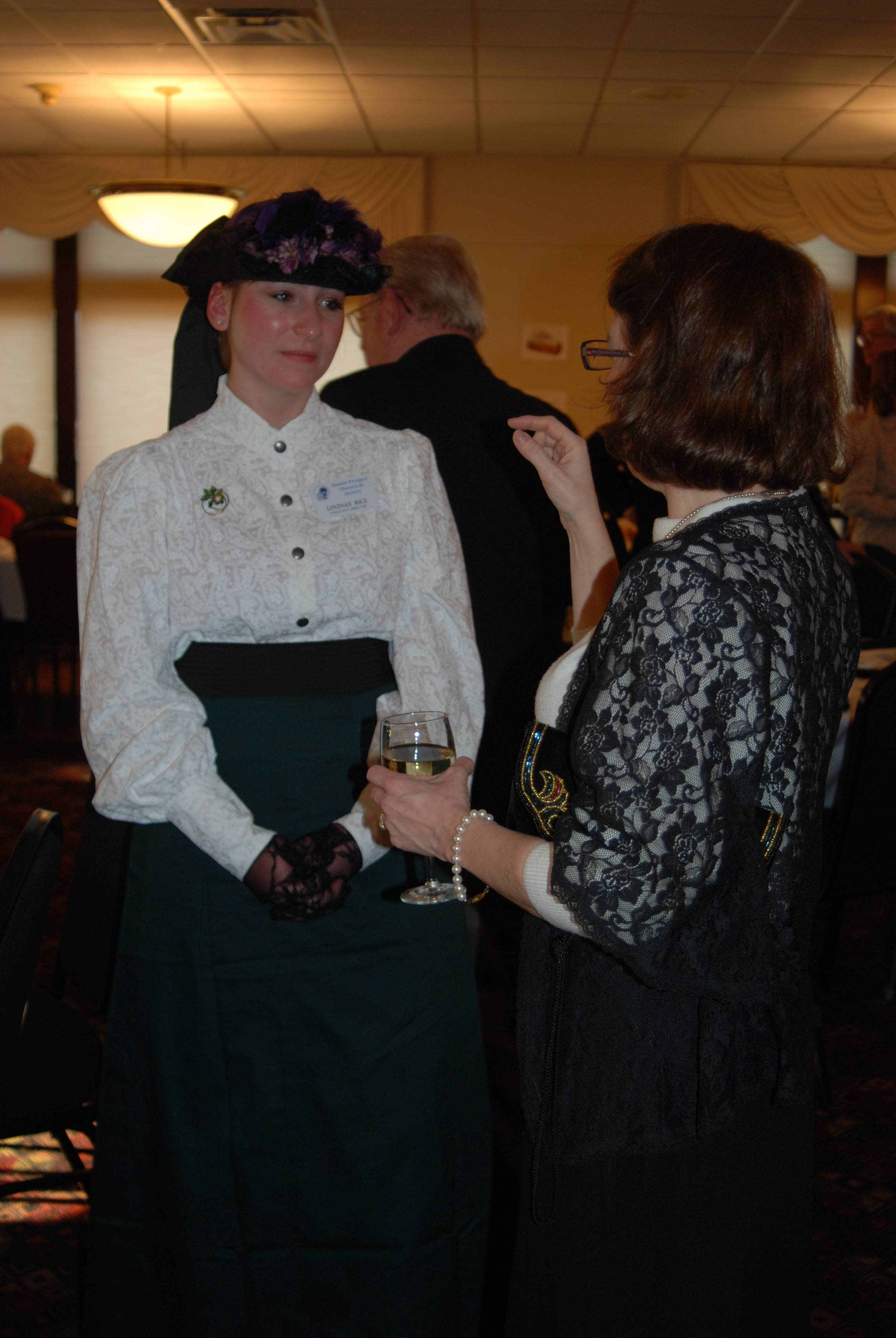 Mount Prospect Historical Society Executive Director Lindsay Rice, left, talks about costumes with Katie Kelly of Arlington Heights at a dinner celebrating the 120th anniversary of the World's Columbian Exposition in Chicago.