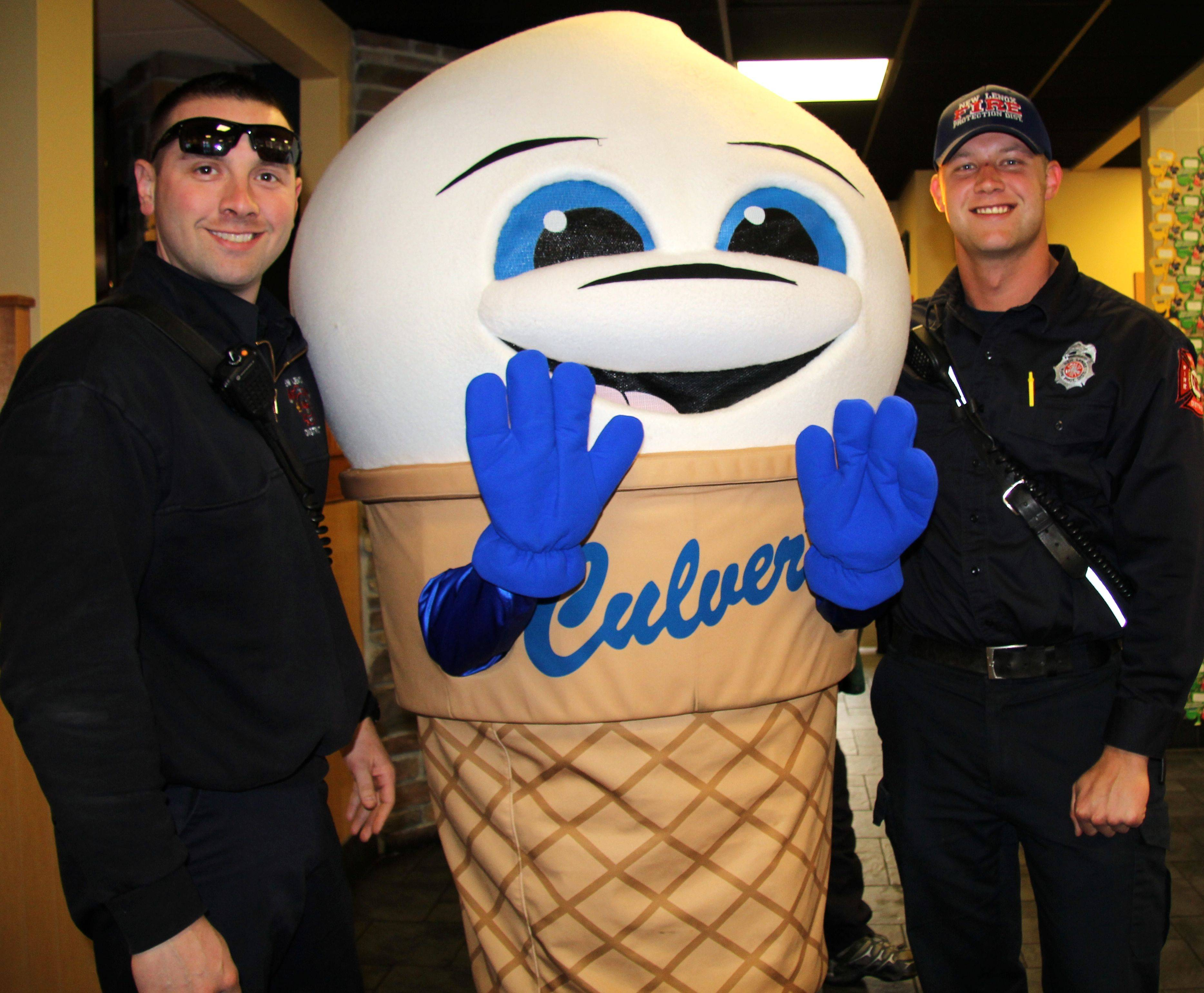 Scoopie, Culver's official mascot, takes a picture with two New Lenox firefighters during a March 4 fundraiser at Culver's of New Lenox.Dave Silbar