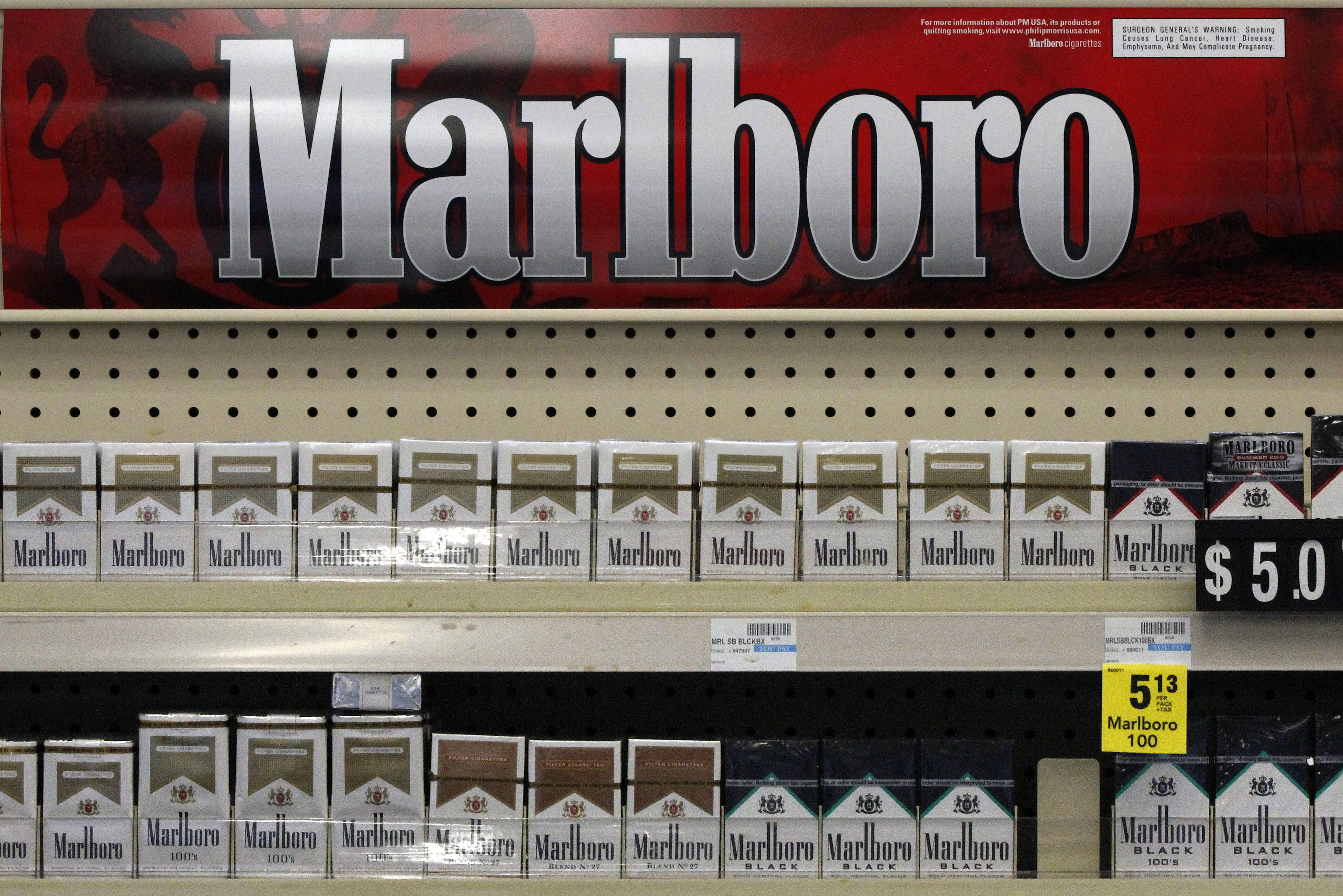 Marlboro cigarettes on display in a CVS store in Pittsburgh. Major retailers will be paying close attention to the sales numbers after CVS Caremark pulls tobacco from its shelves by October.