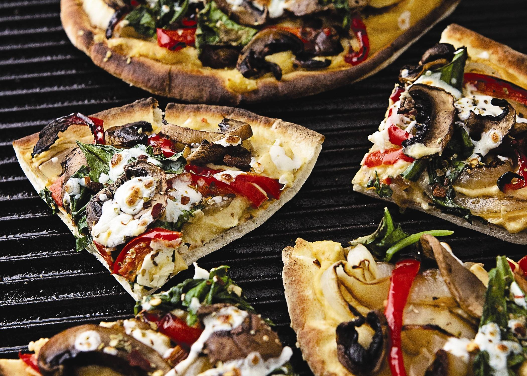See the recipe for this Grilled Flatbread with Hummus & Mixed Veggies and more pizzas on the grill on Page 4.