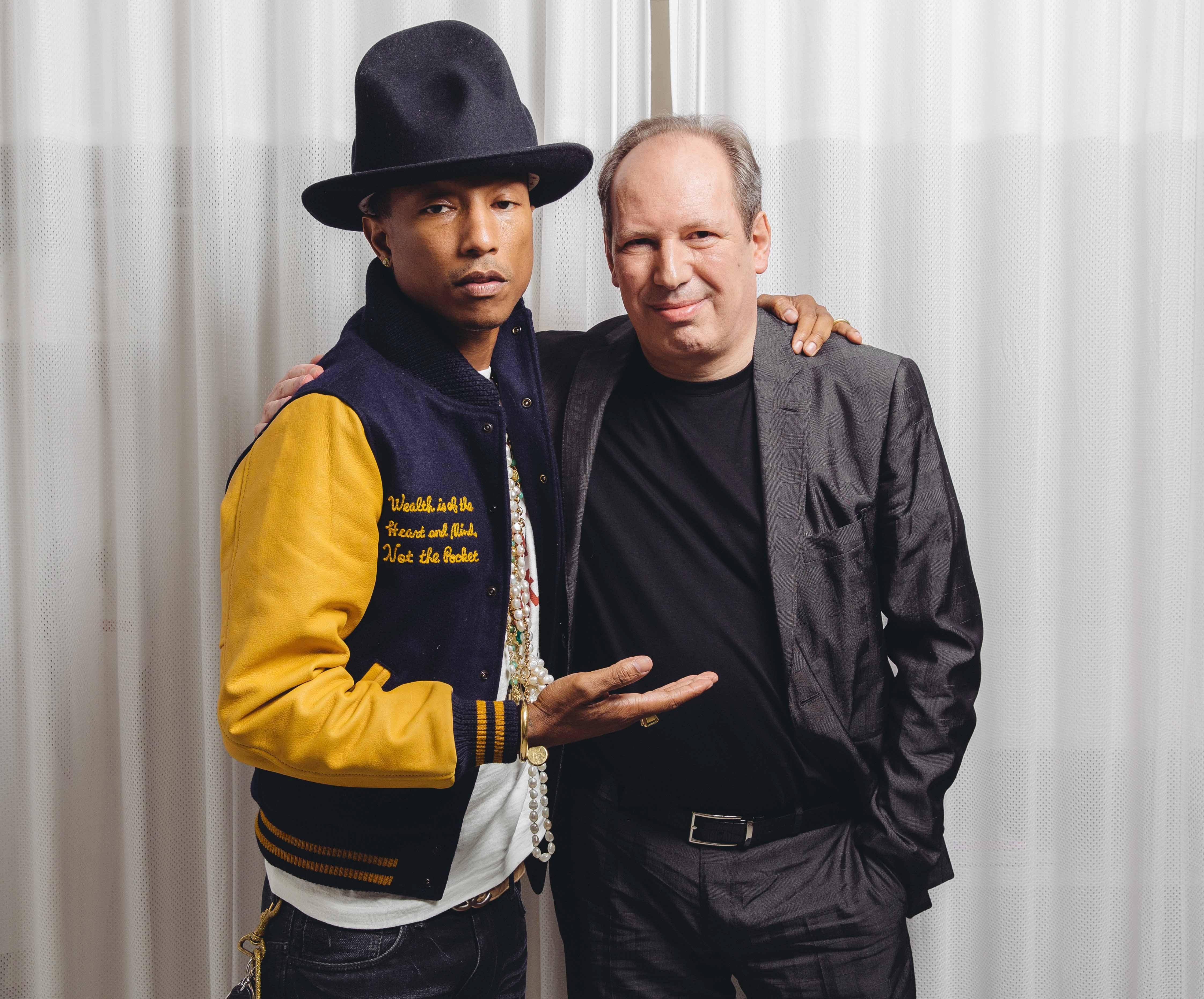 "Pharrell Williams, left, and Hans Zimmer created such a collaborative atmosphere on the soundtrack for ""The Amazing Spider-Man 2"" that changes were introduced to the movie itself. The film releases May 2, 2014."