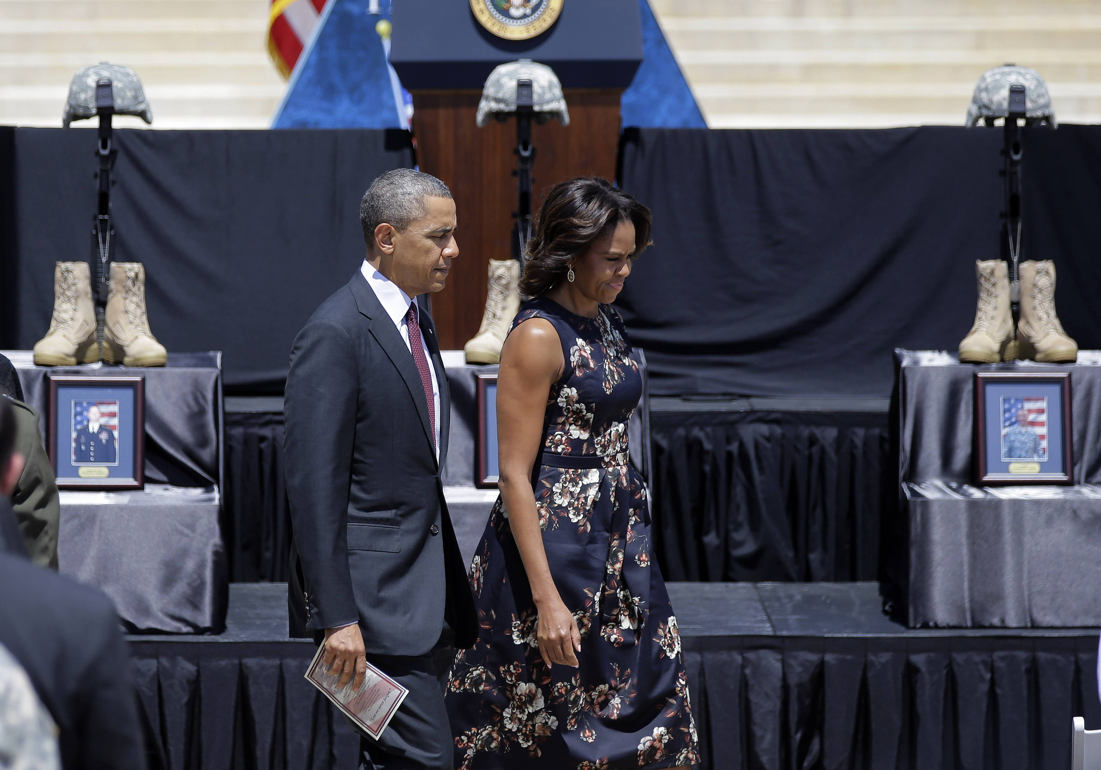 President Barack Obama and first lady Michelle Obama arrive at a memorial ceremony for the Fort Hood shooting victims Wednesday at Fort Hood, Texas. The shooting rampage left four dead and more than a dozen injured.