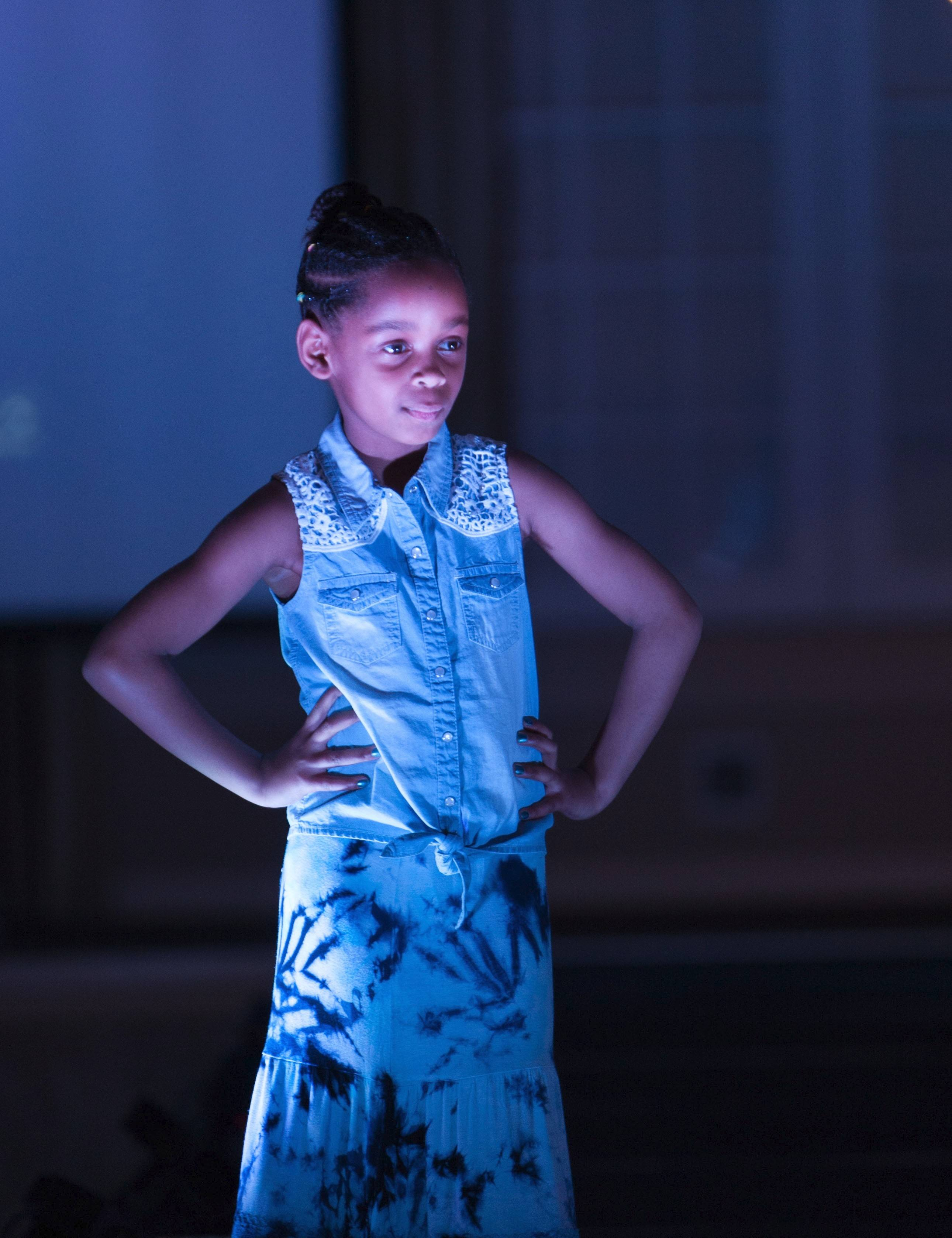 Kayla Hadfield, 7, daughter of Christopher and Eileen Hadfield of Algonquin, takes the stage at St. Mary's Services' fundraiser fashion show.