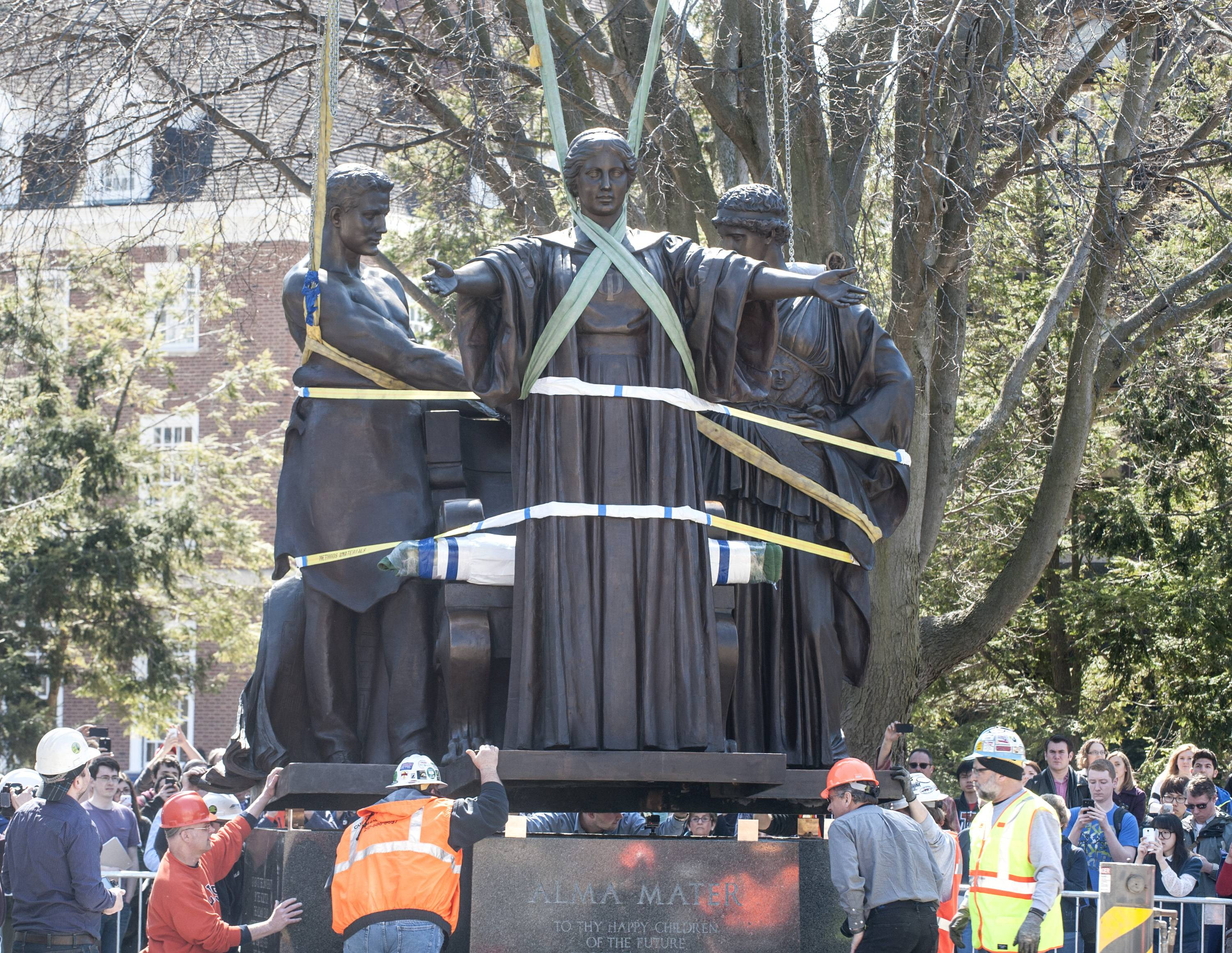 The University of Illinois' Alma Mater sculpture is set onto its base Wednesday in front of Altgeld Hall in Urbana.