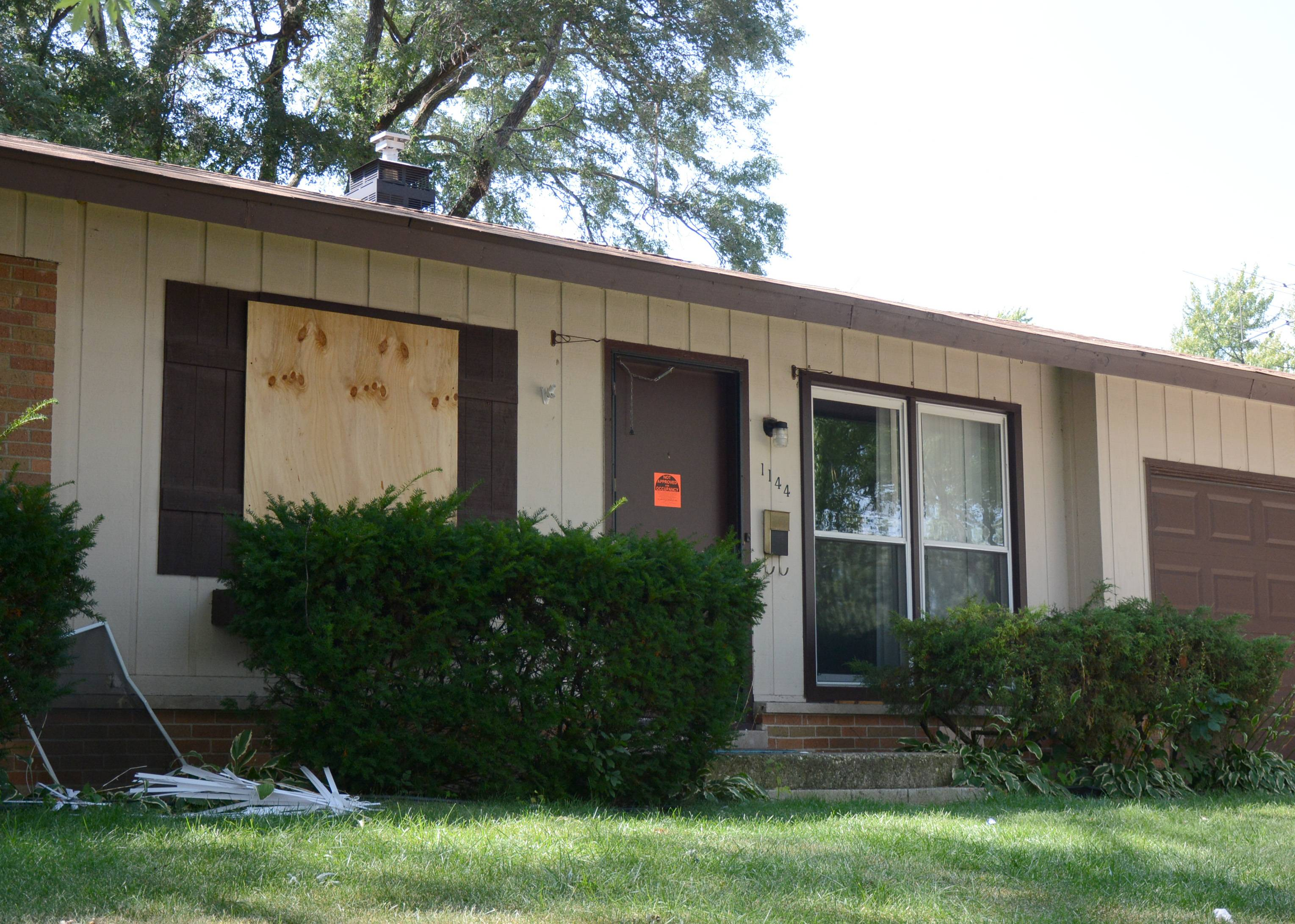 A house sits with windows boarded on Aug. 30, 2013, after the Elk Grove Village Police Department conducted a drug raid on the building Thursday. Such a drug raid is what inspired the village's crime-free rental housing policy.